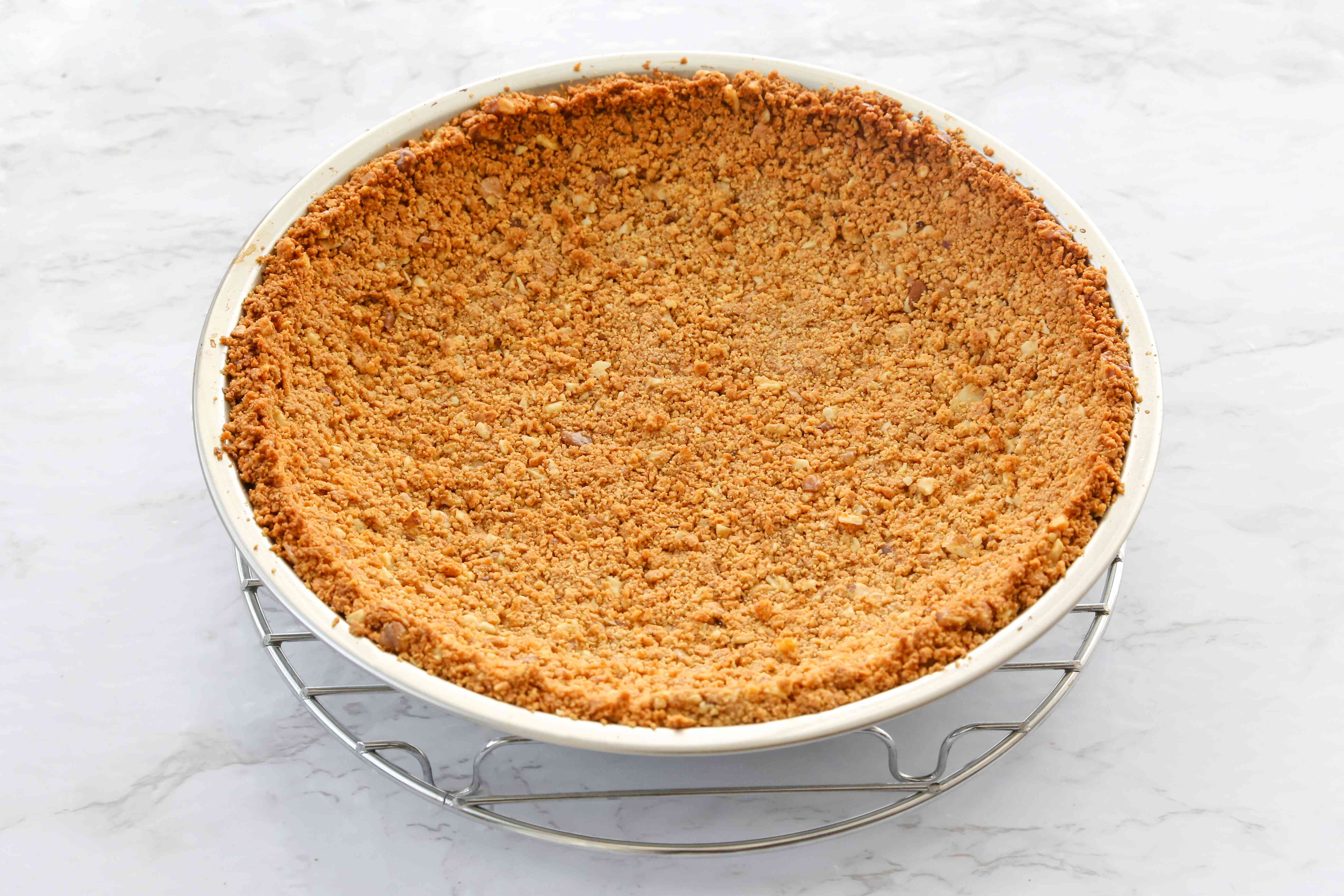 baked pie crust on a cooling rack