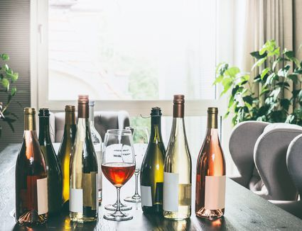 bottles of wine on a dining room table