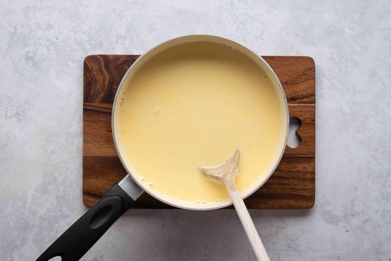 Add vanilla and rum to the custard mixture in the saucepan