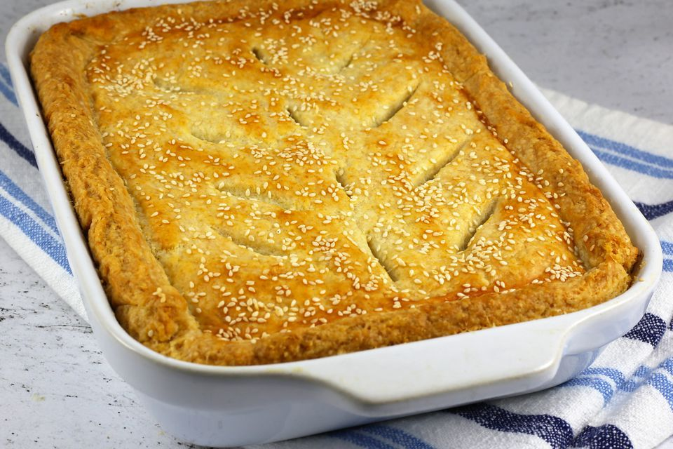 Chicken pot pie with herbs, topped with sesame seeds