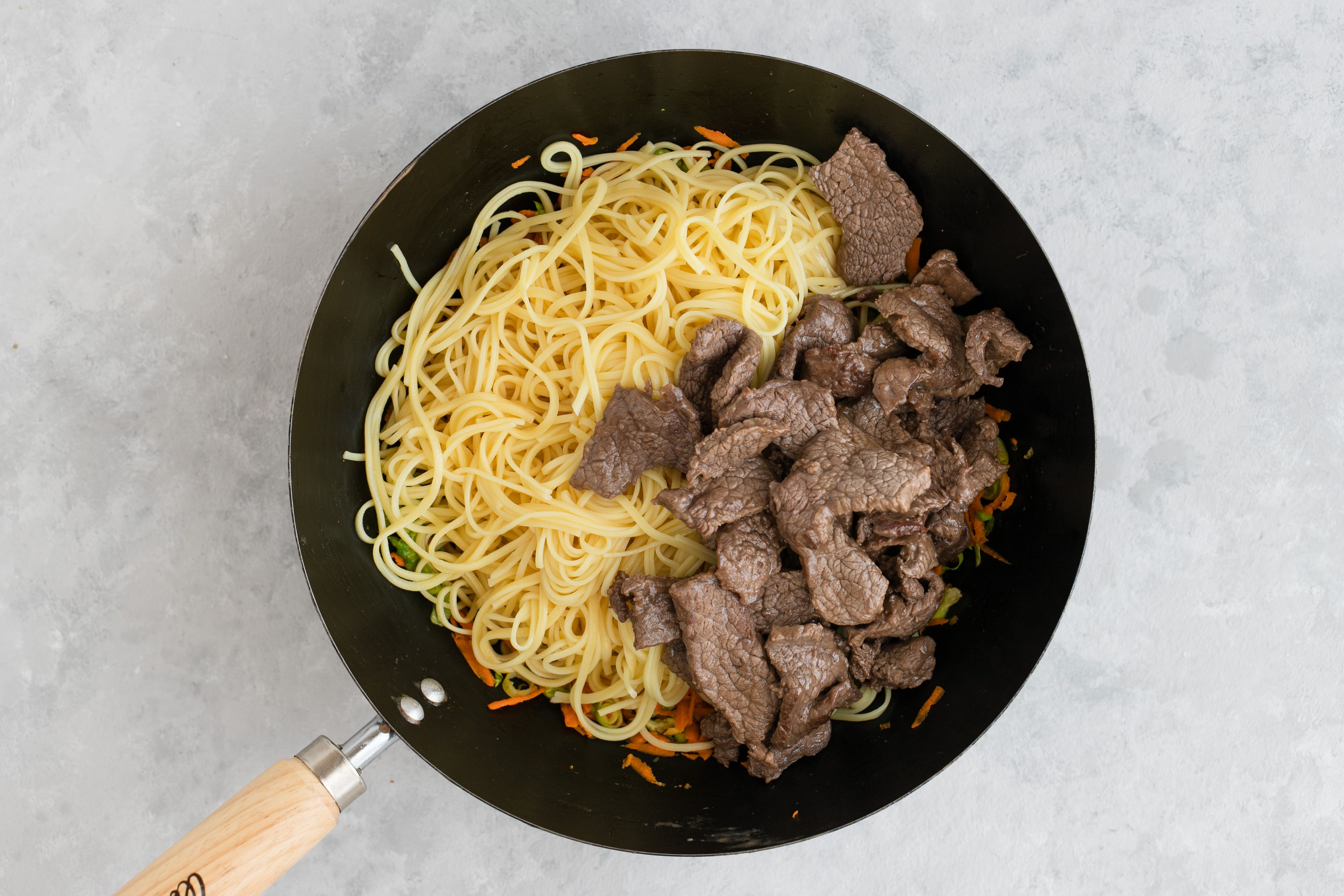 Beef and noodles in wok