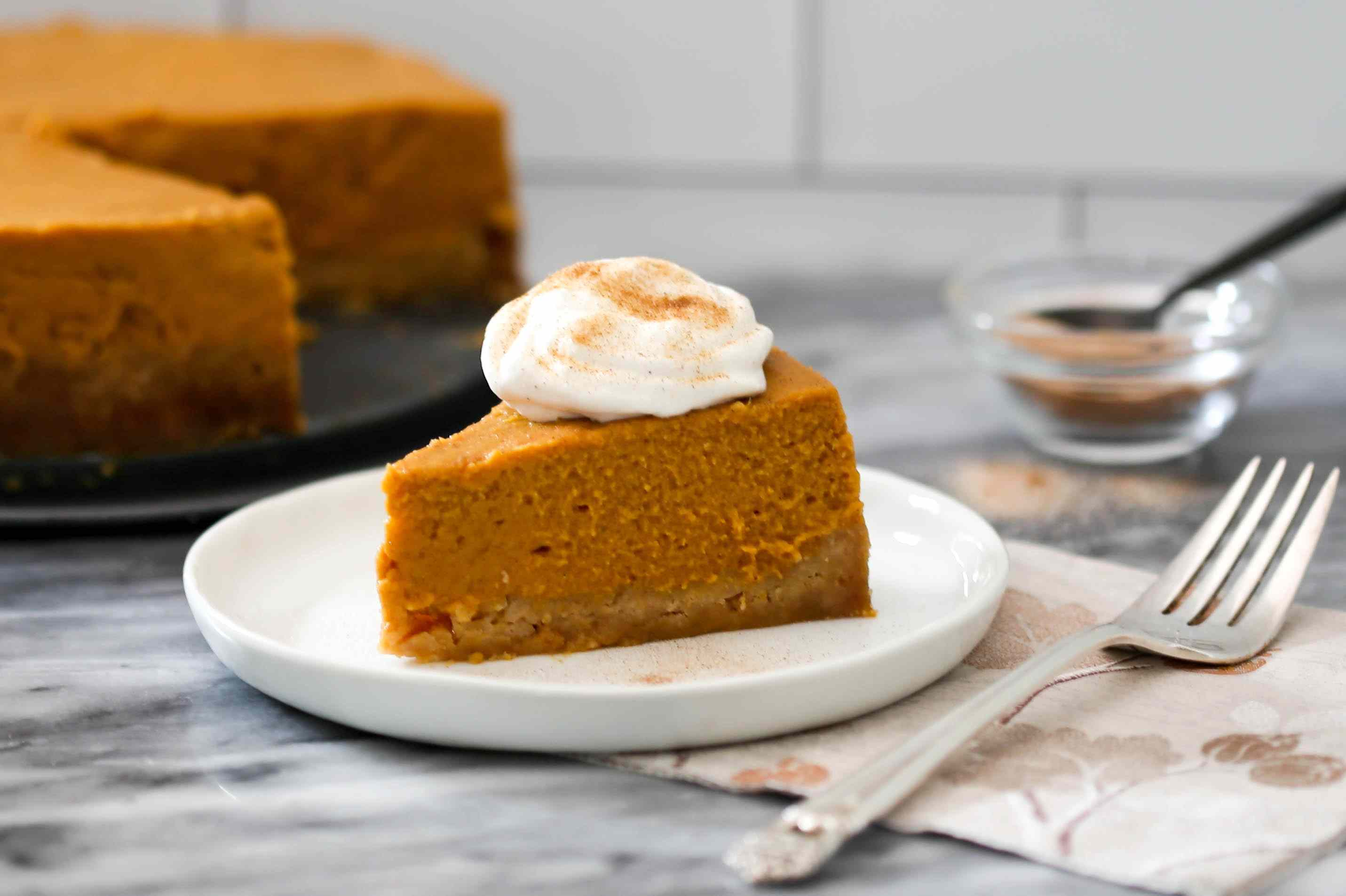 Instant Pot pumpkin pie slice with whipped cream.
