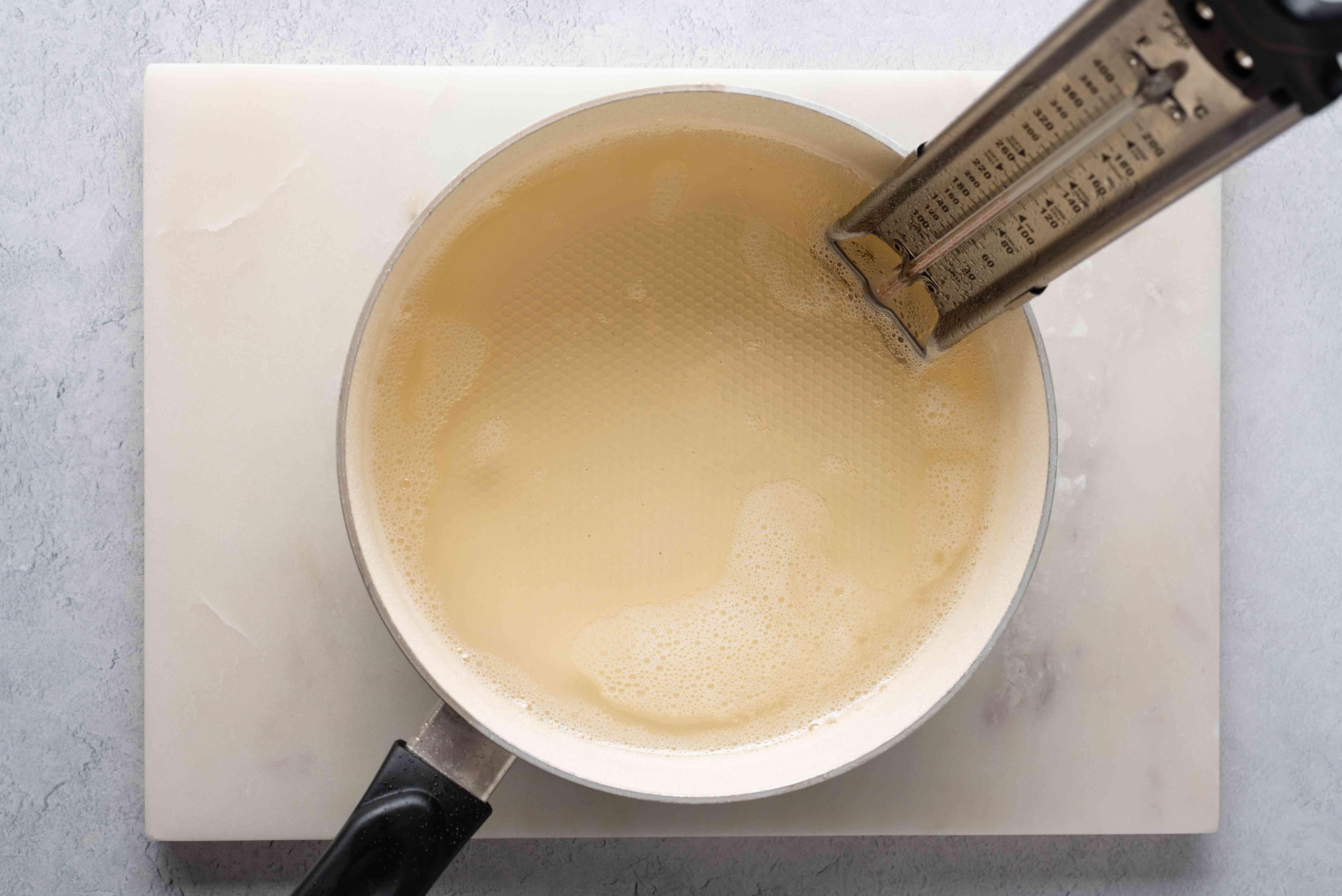 sugar mixture cooking in a saucepan
