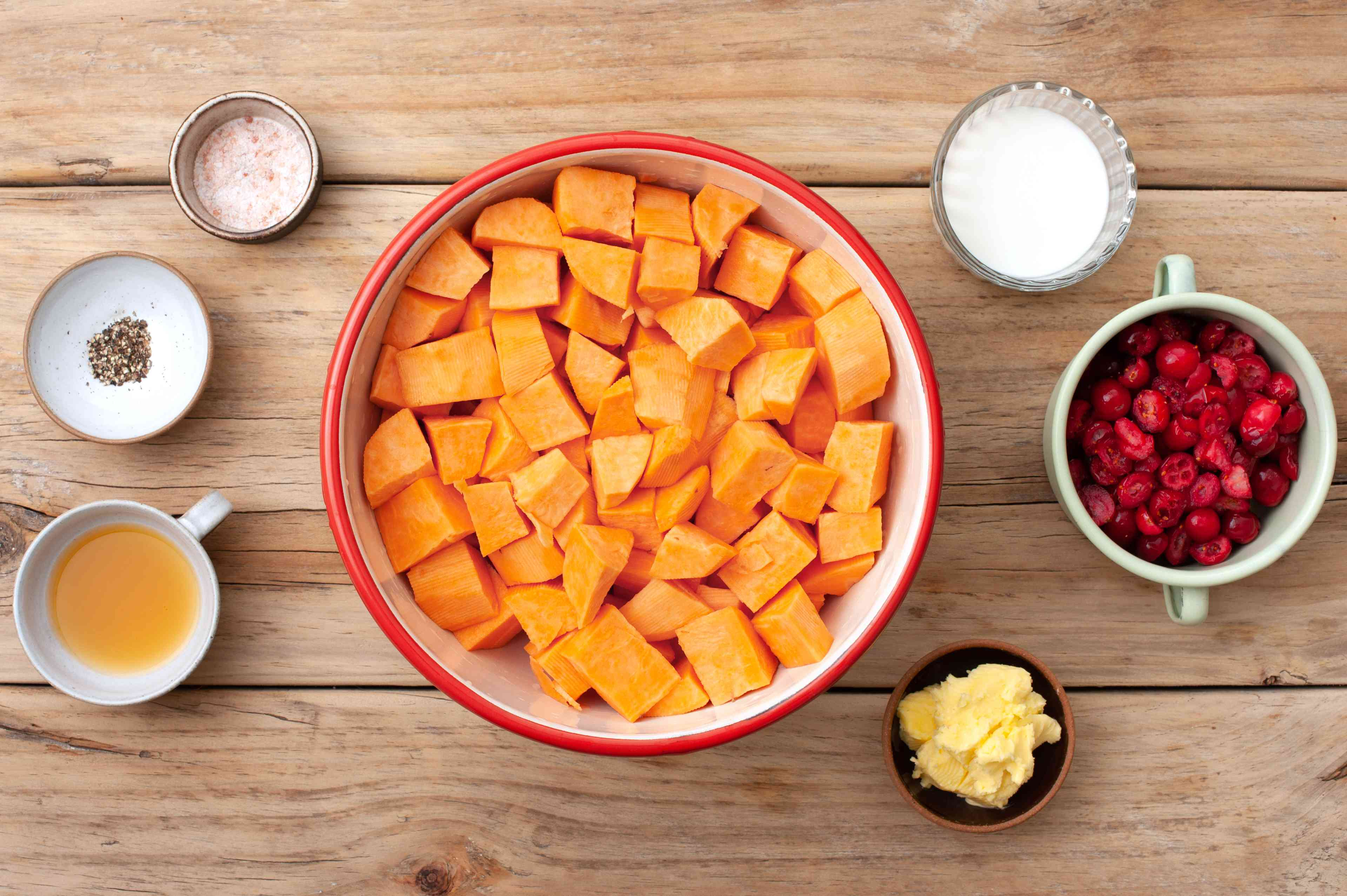 Ingredients for mashed sweet potatoes with orange juice and cranberries