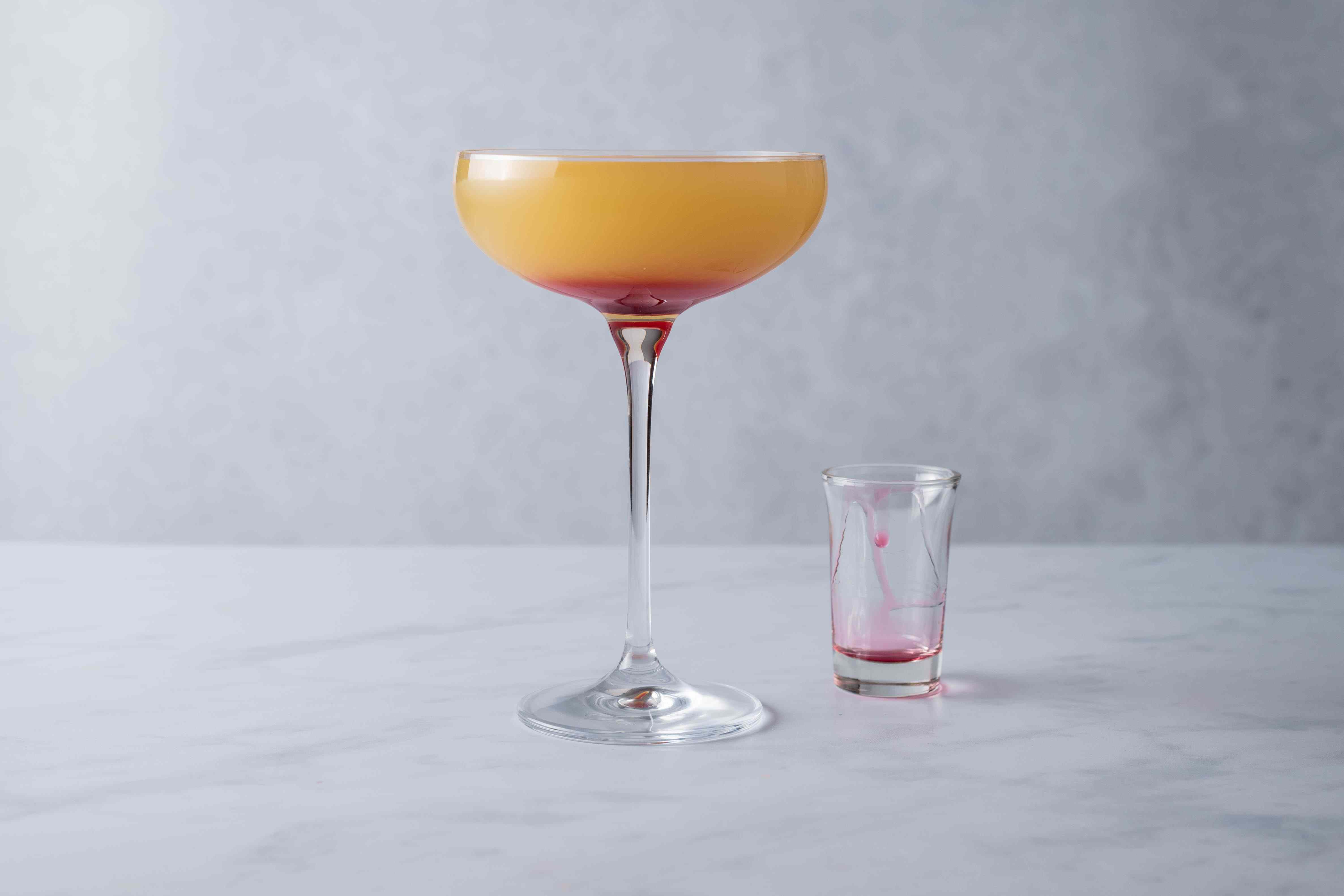Top the cocktail with grenadine