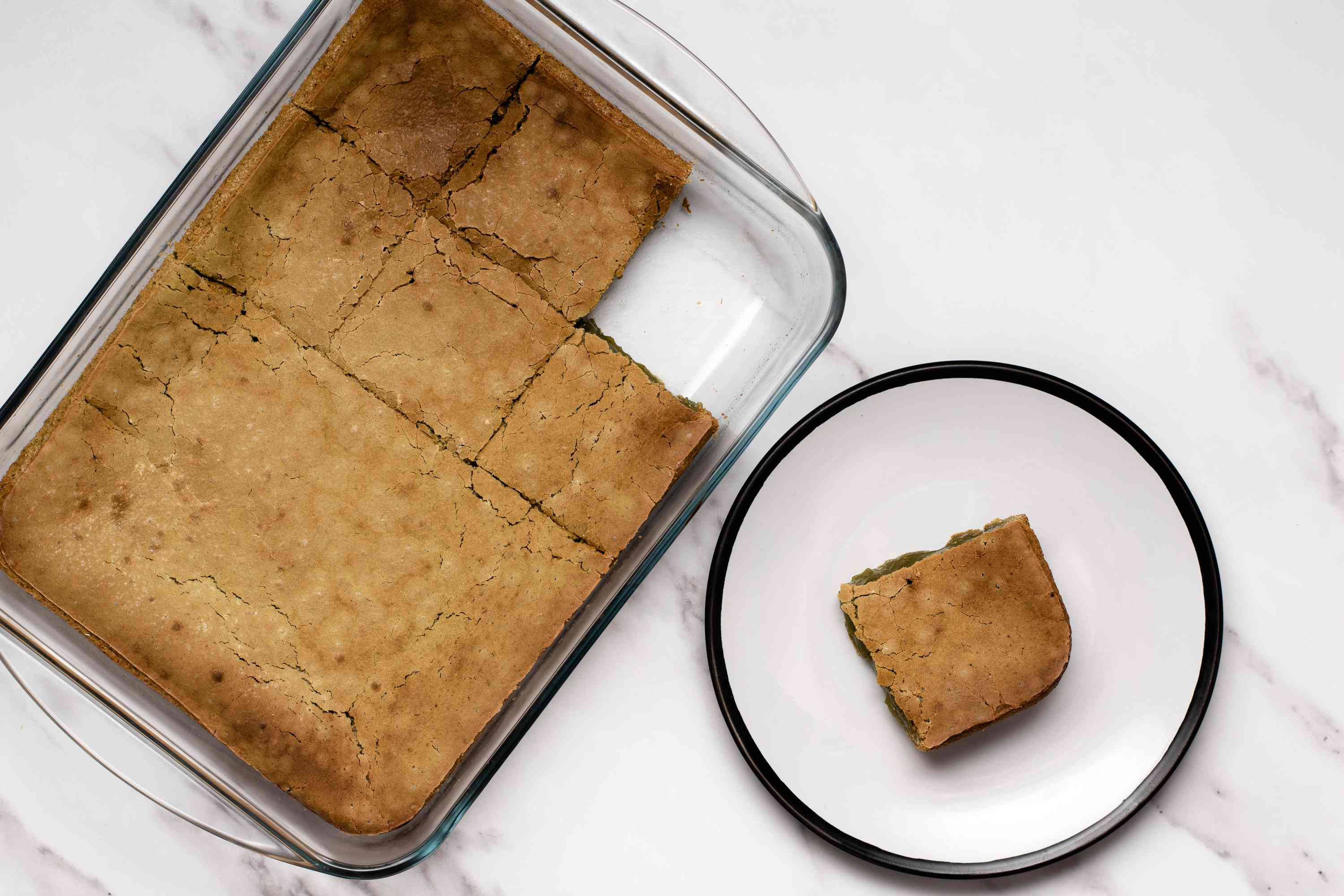 baked mochi in a baking dish, piece of baked mochi on a plate