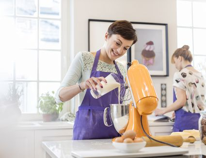 woman using stand mixer