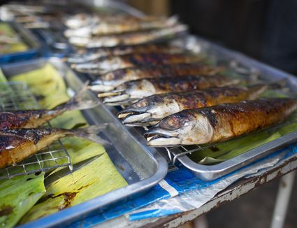 Barbecued sardines on sale at Maeklong market