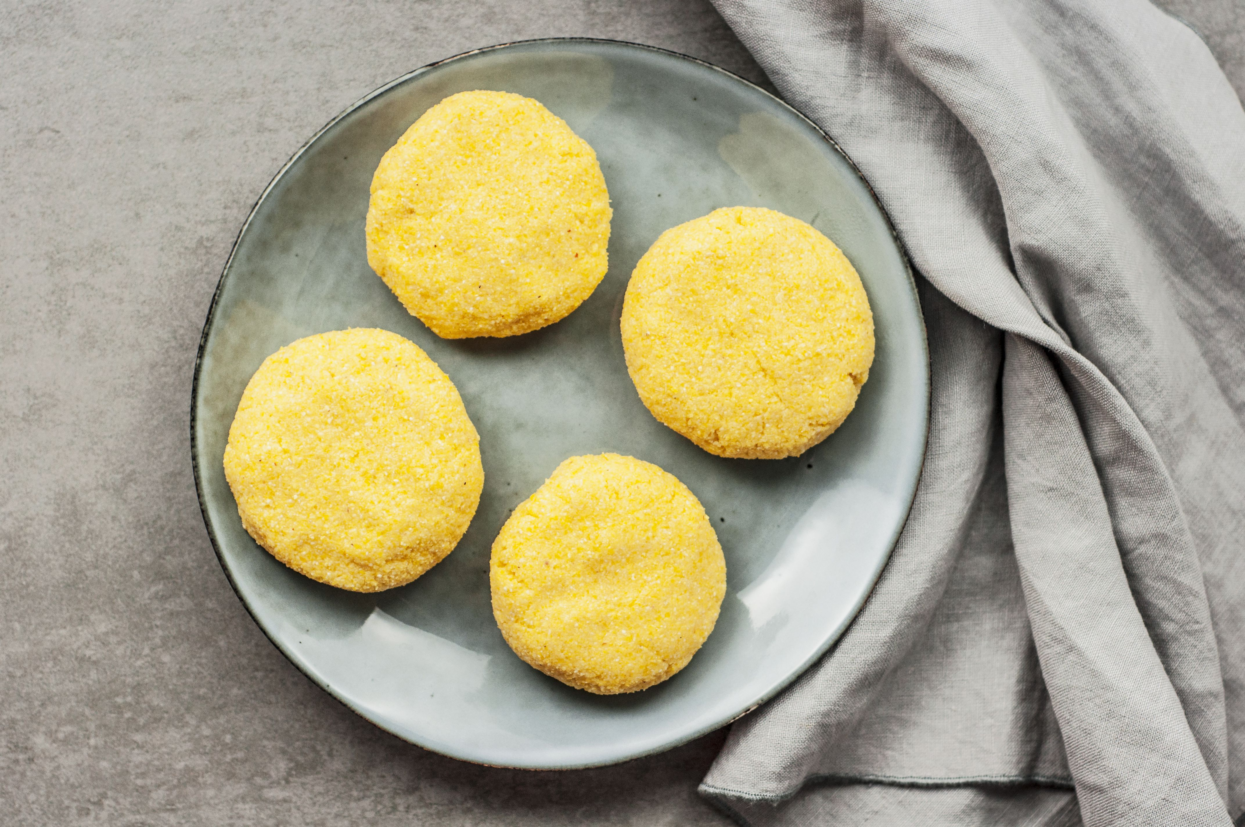 Mixture is formed into four cornbreads on a plate