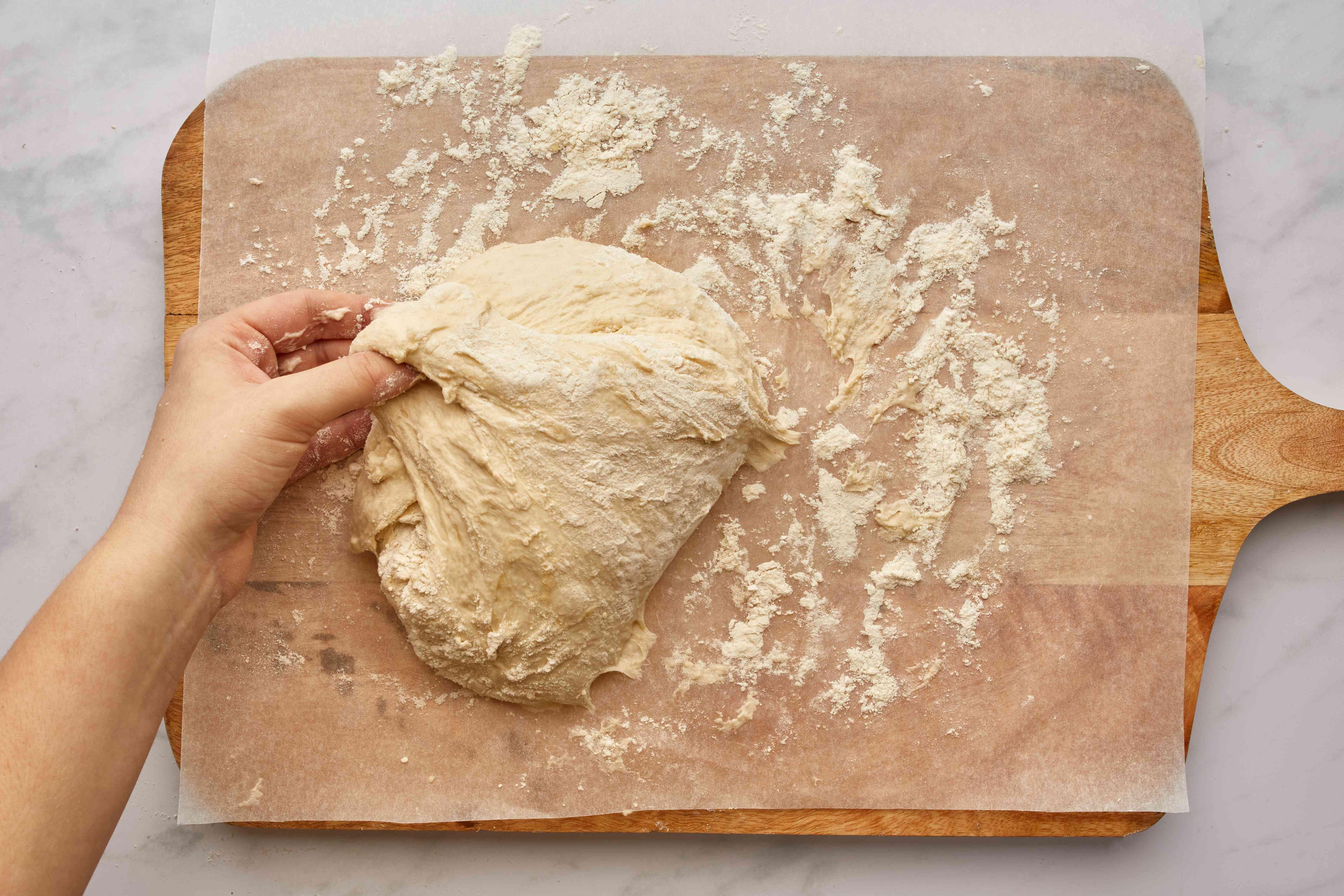fold dough on floured surface