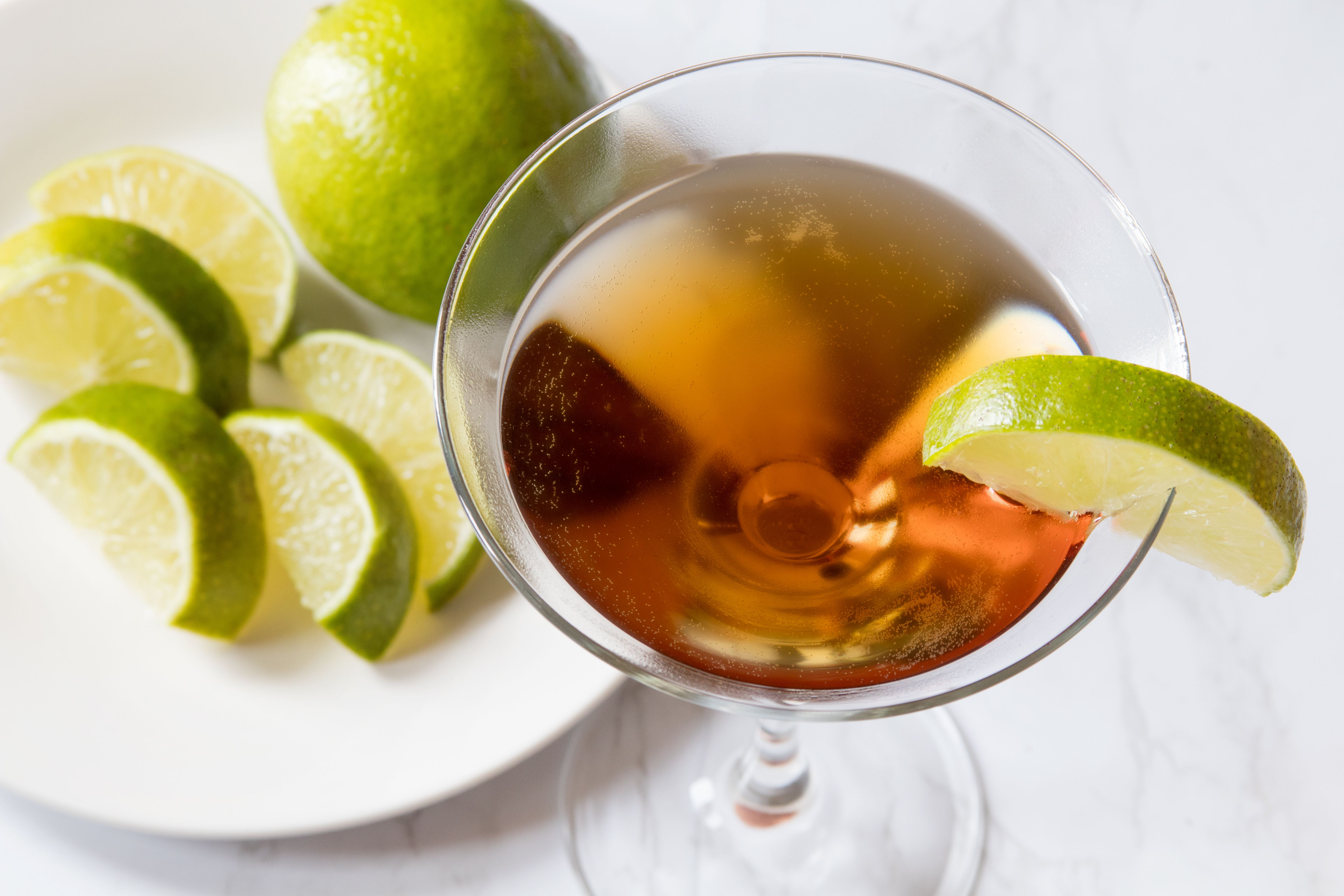 Embassy Cocktail Garnished With a Lime