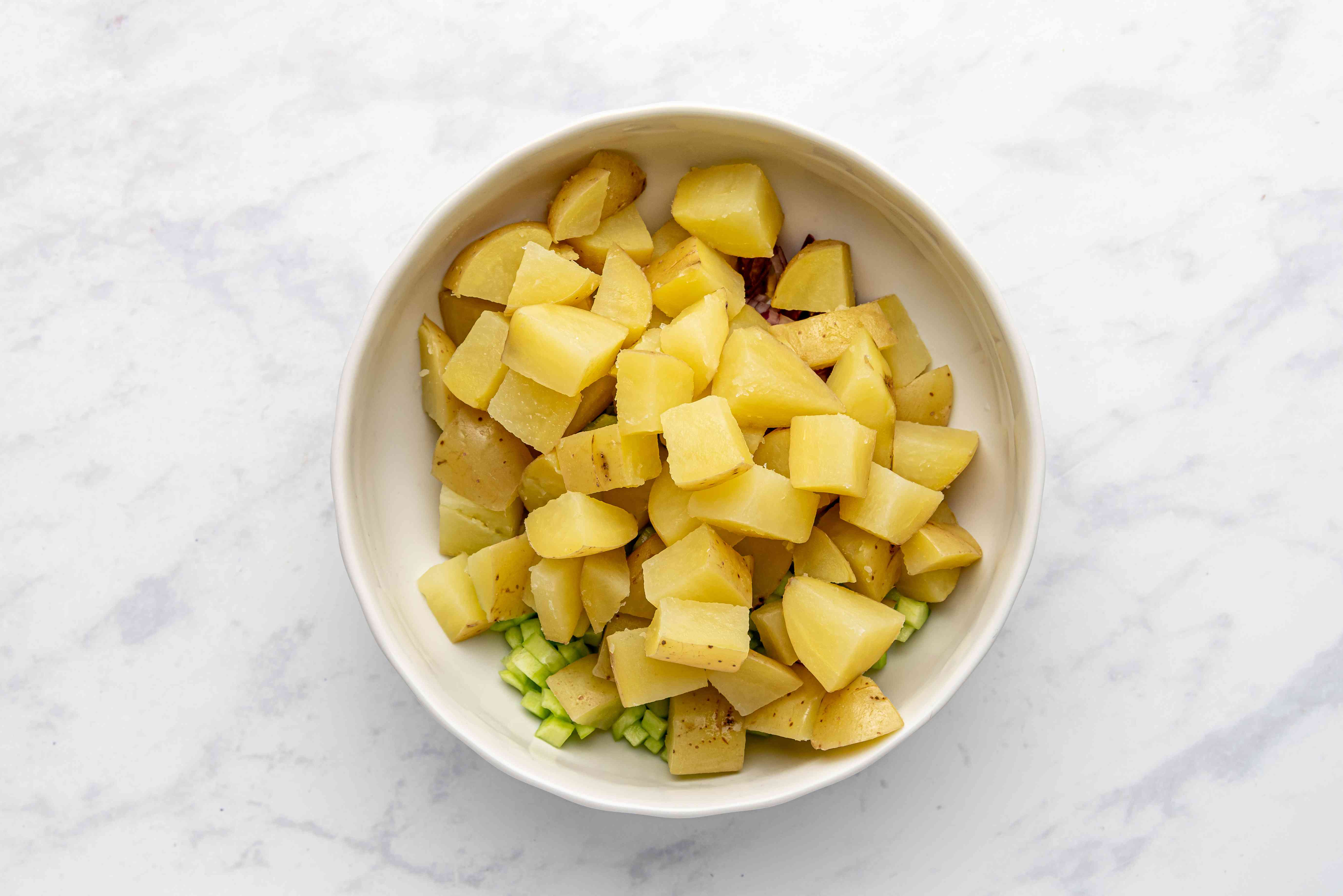 add potatoes to the mixture in the bowl