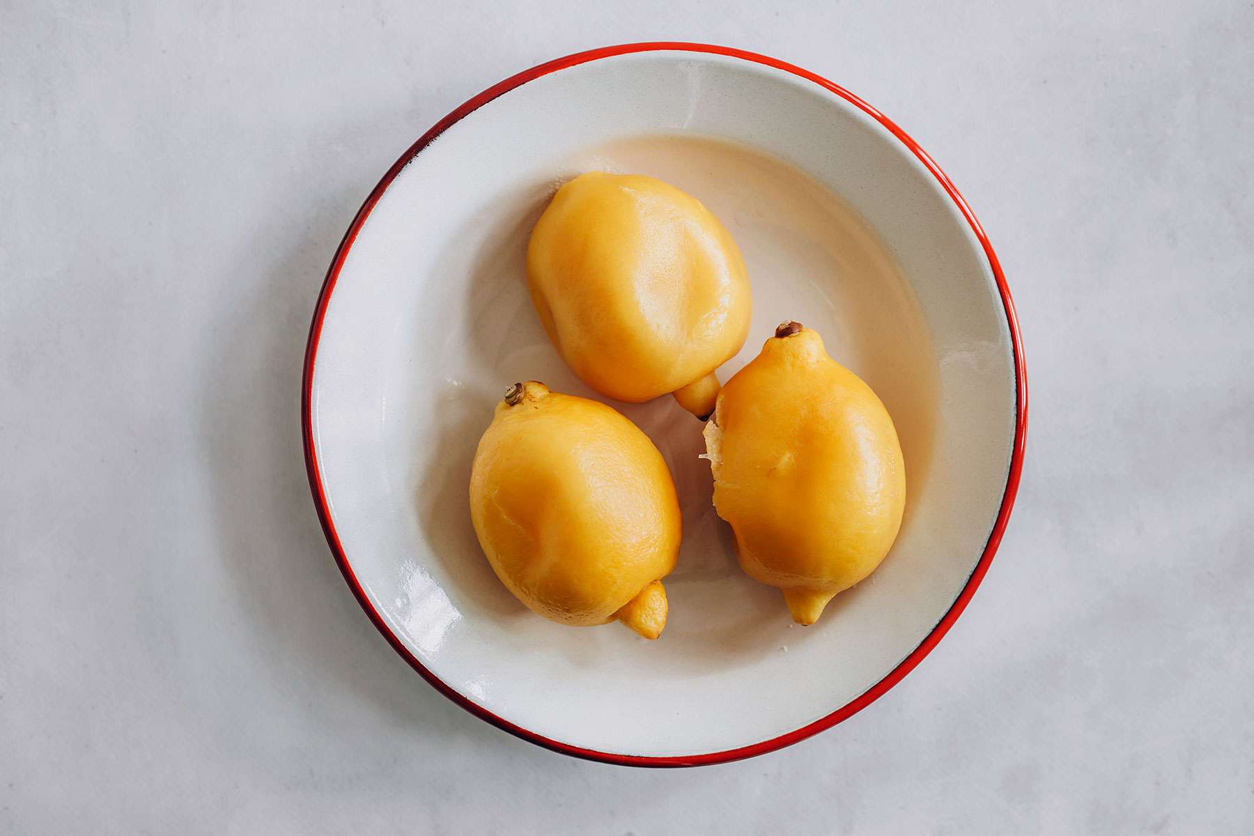 Simmered lemons on a plate