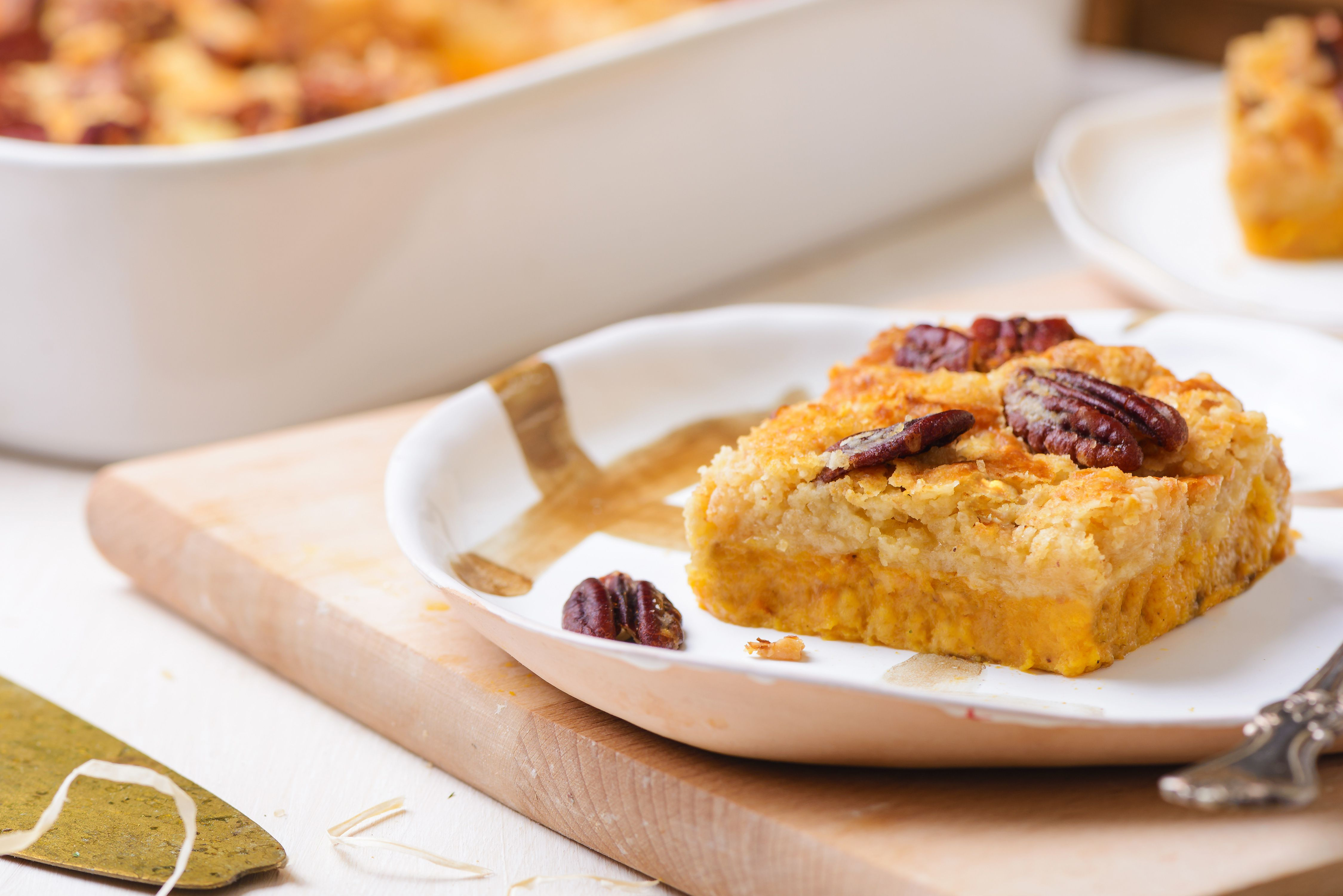 Easy pumpkin dump cake with nuts on a plate