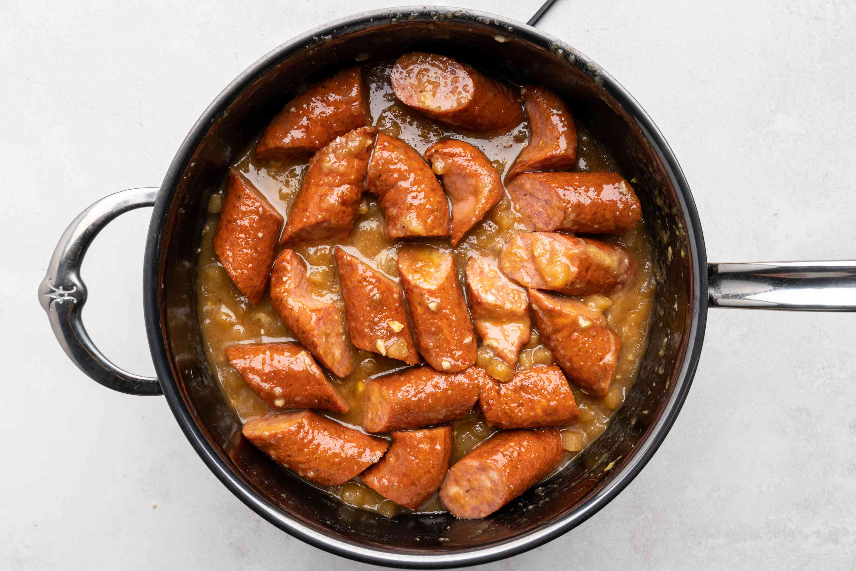 sausage with the brown sugar, applesauce, mustard, and garlic in a large saucepan