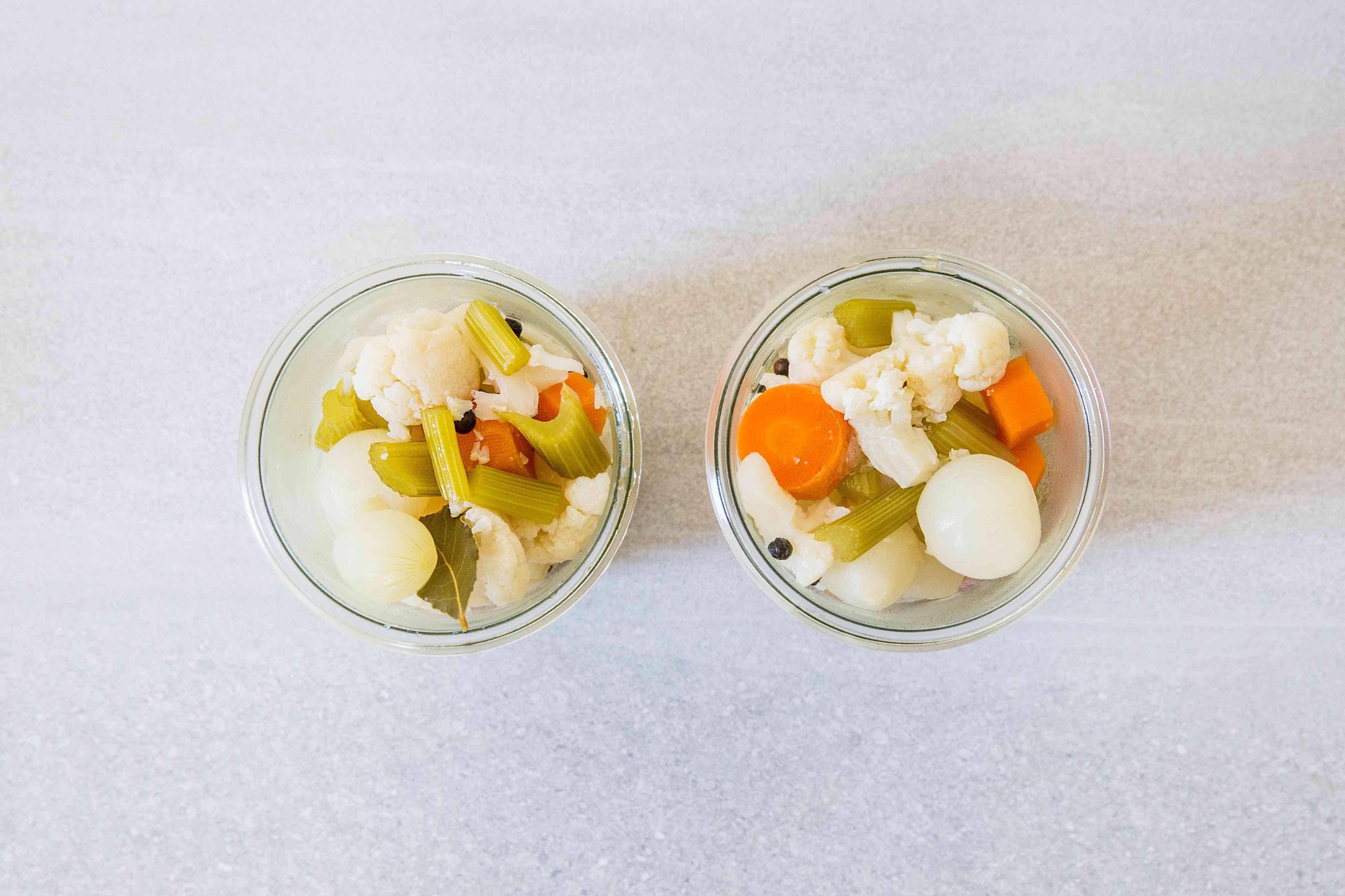 Vegetables in the vinegar mixture in jars