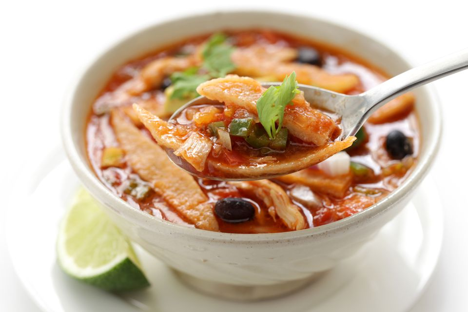 This homemade cuisine is vegetarian Mexican tortilla soup.