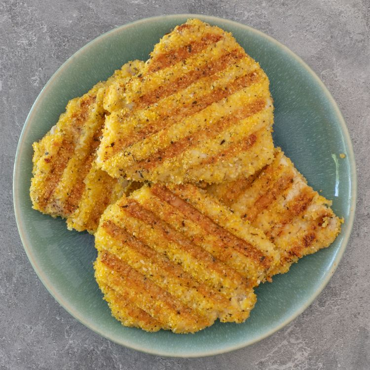 Cornmeal crispy chicken cooked on a contact grill.