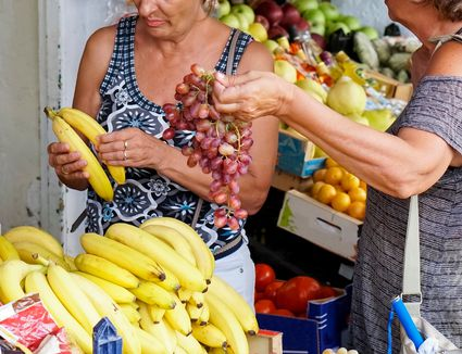 Two grandmothers, or yiayias, explore the marketplace in Corfu, Greece