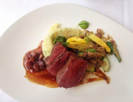 plated bison steak dinner