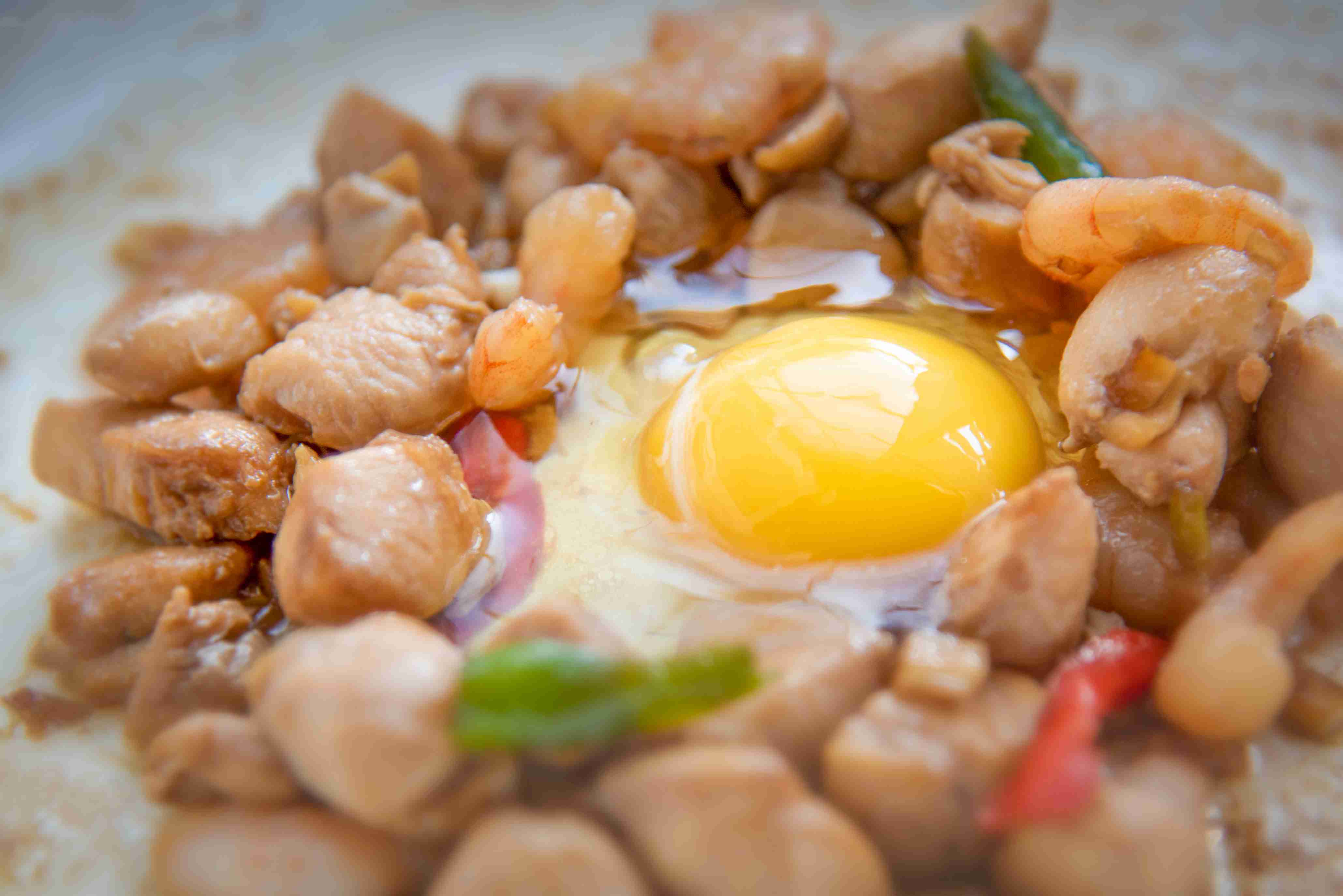 Crack an egg to stir fry in pan and scramble