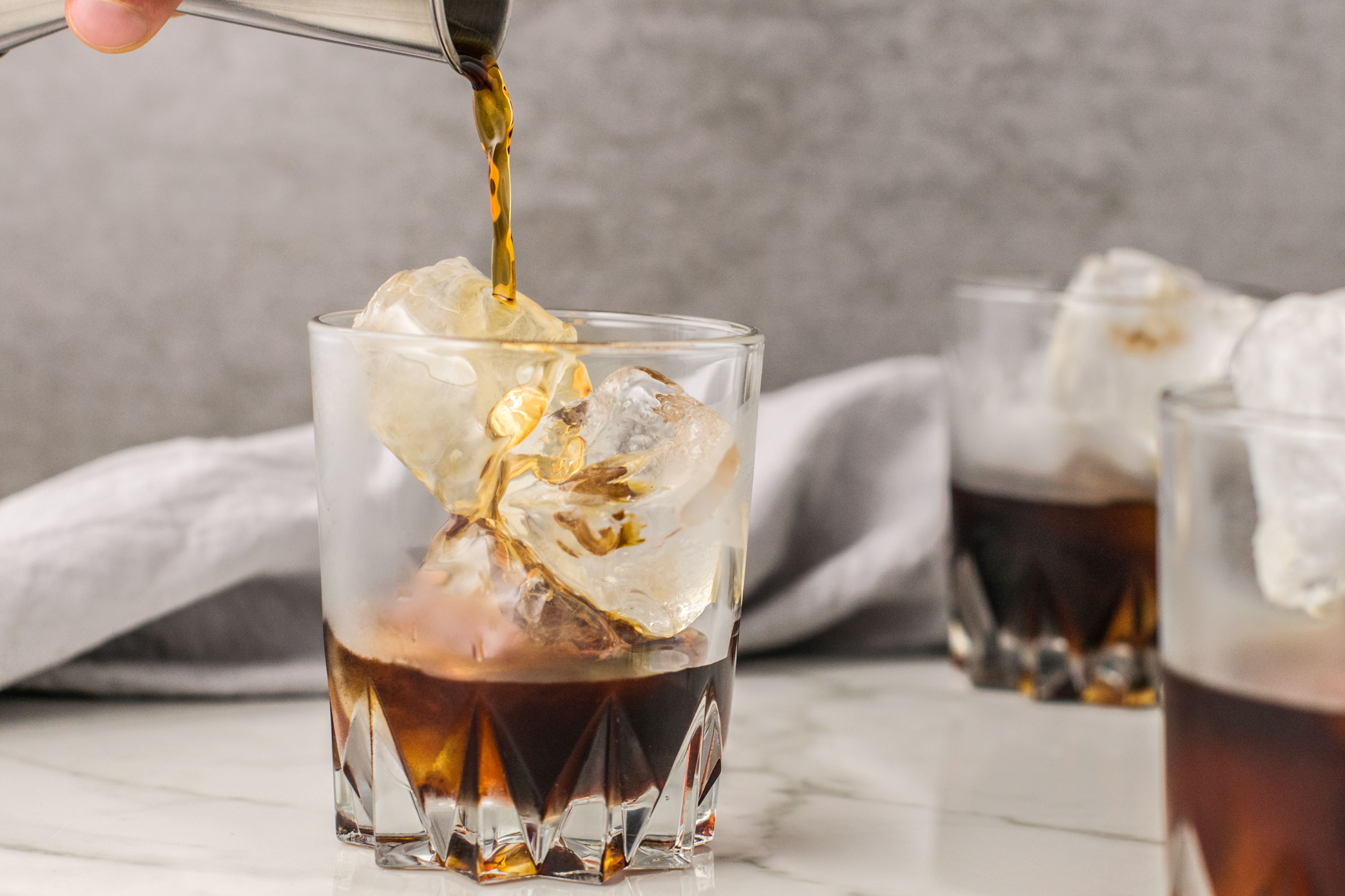 Pouring coffee liqueur over ice
