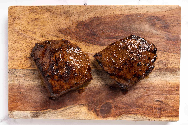 steaks on a wood board