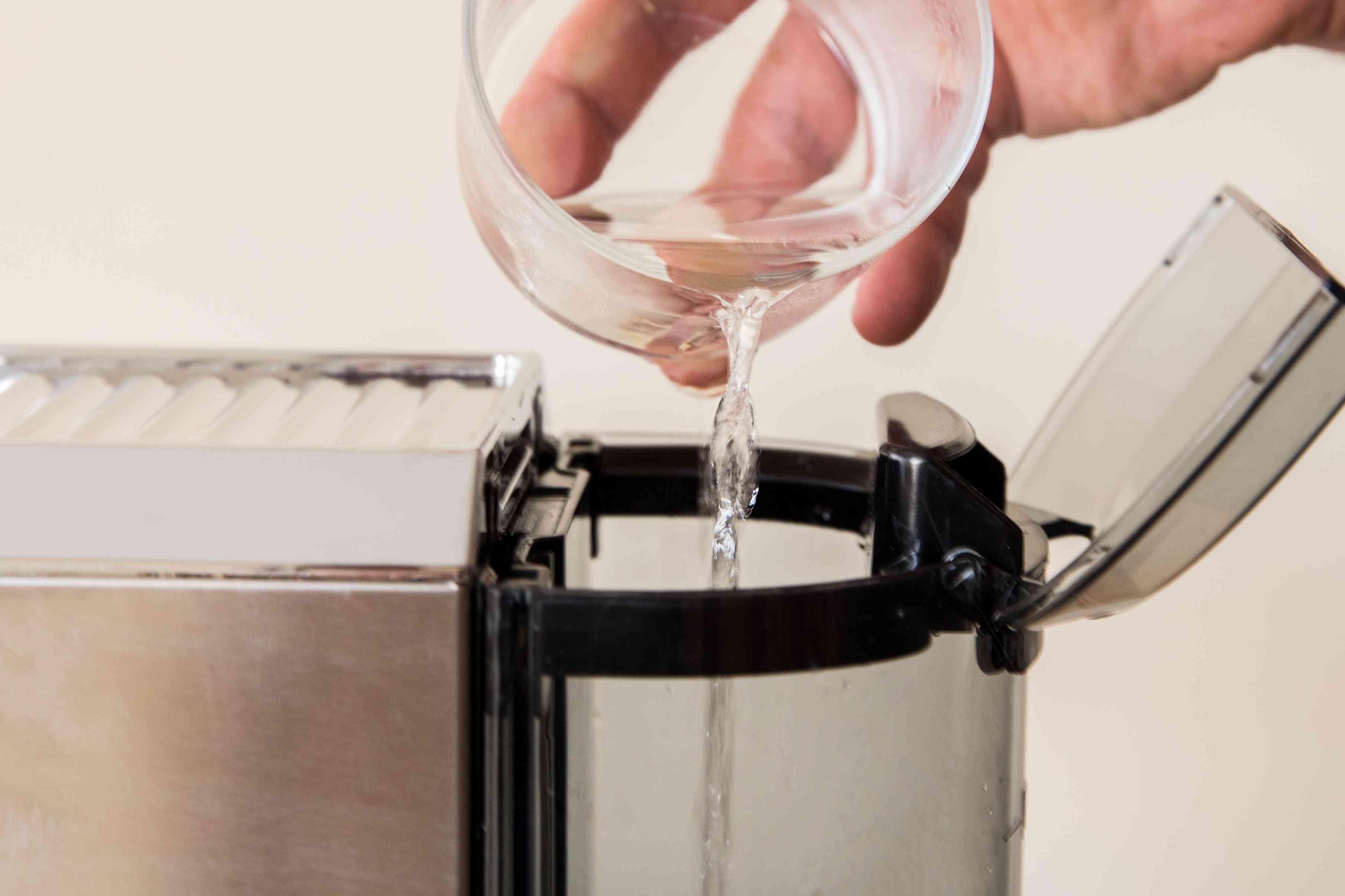 pour water into espresso machine