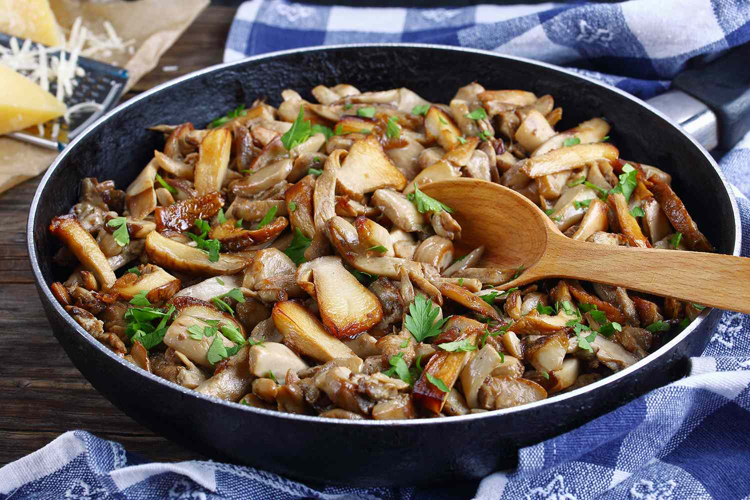 fried porcini with parsley in skillet