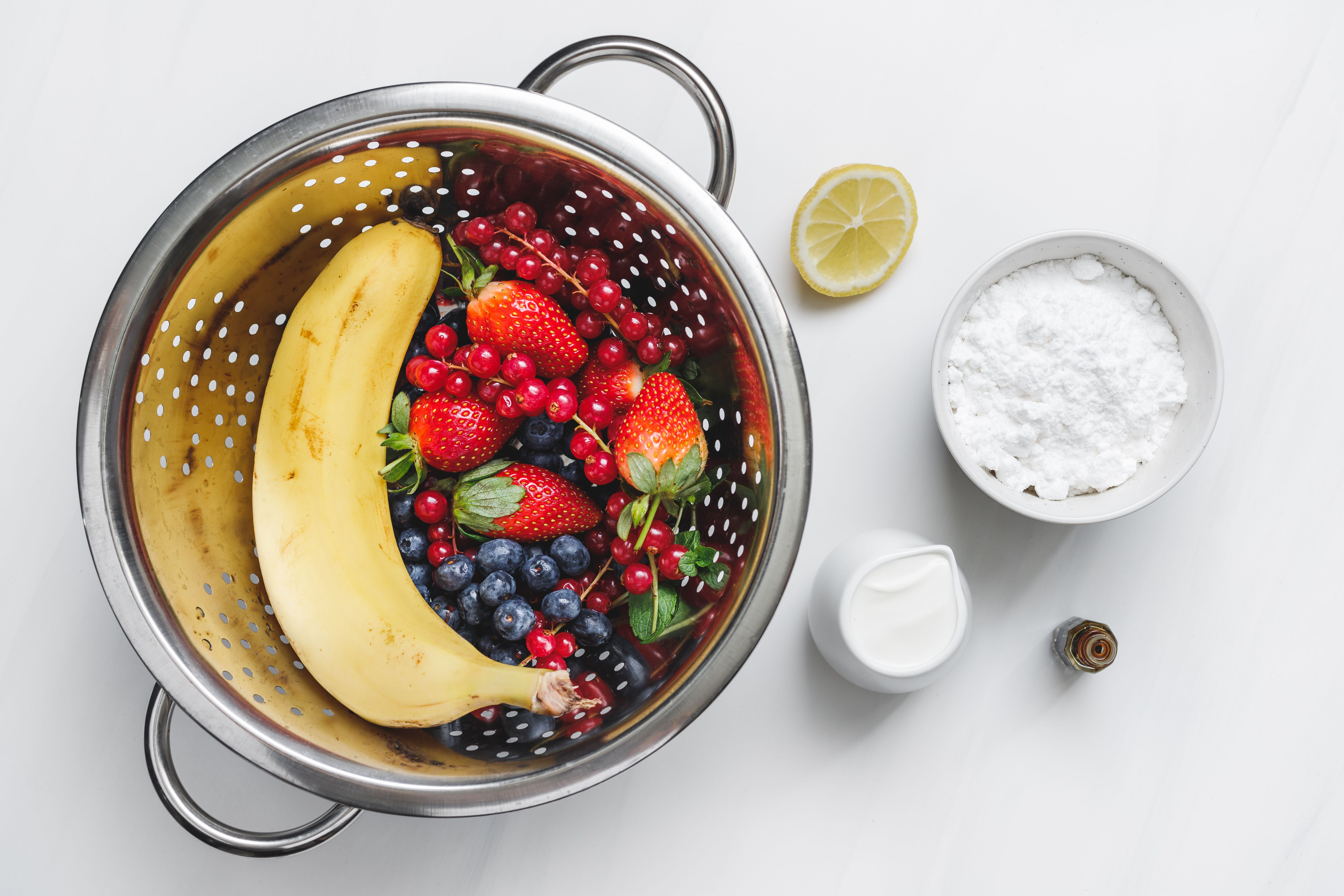 Ingredients for whipped cream and fruit garnish