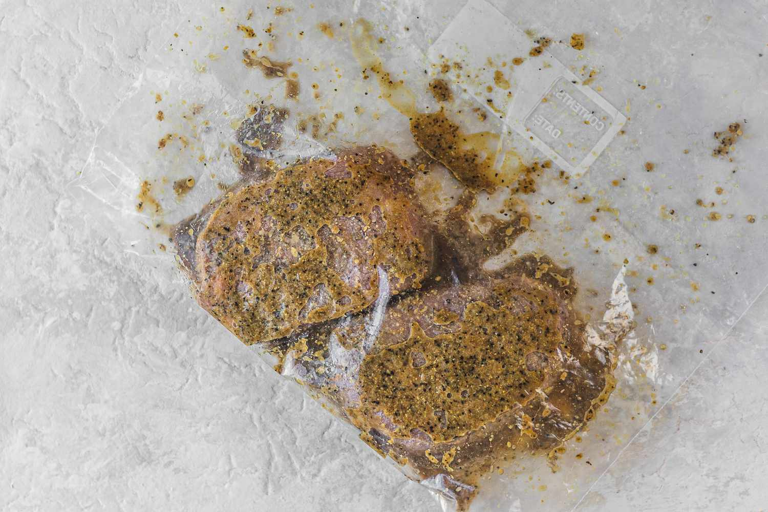 Place the steaks in a resealable plastic bag and pour the marinade over the steaks