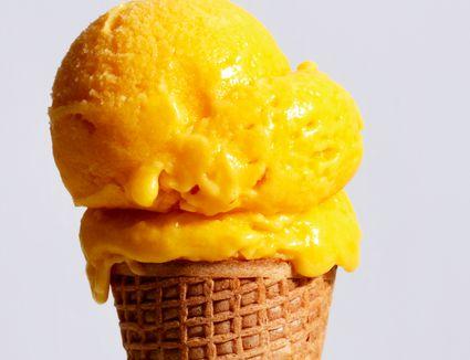 Mango ice cream on a cone