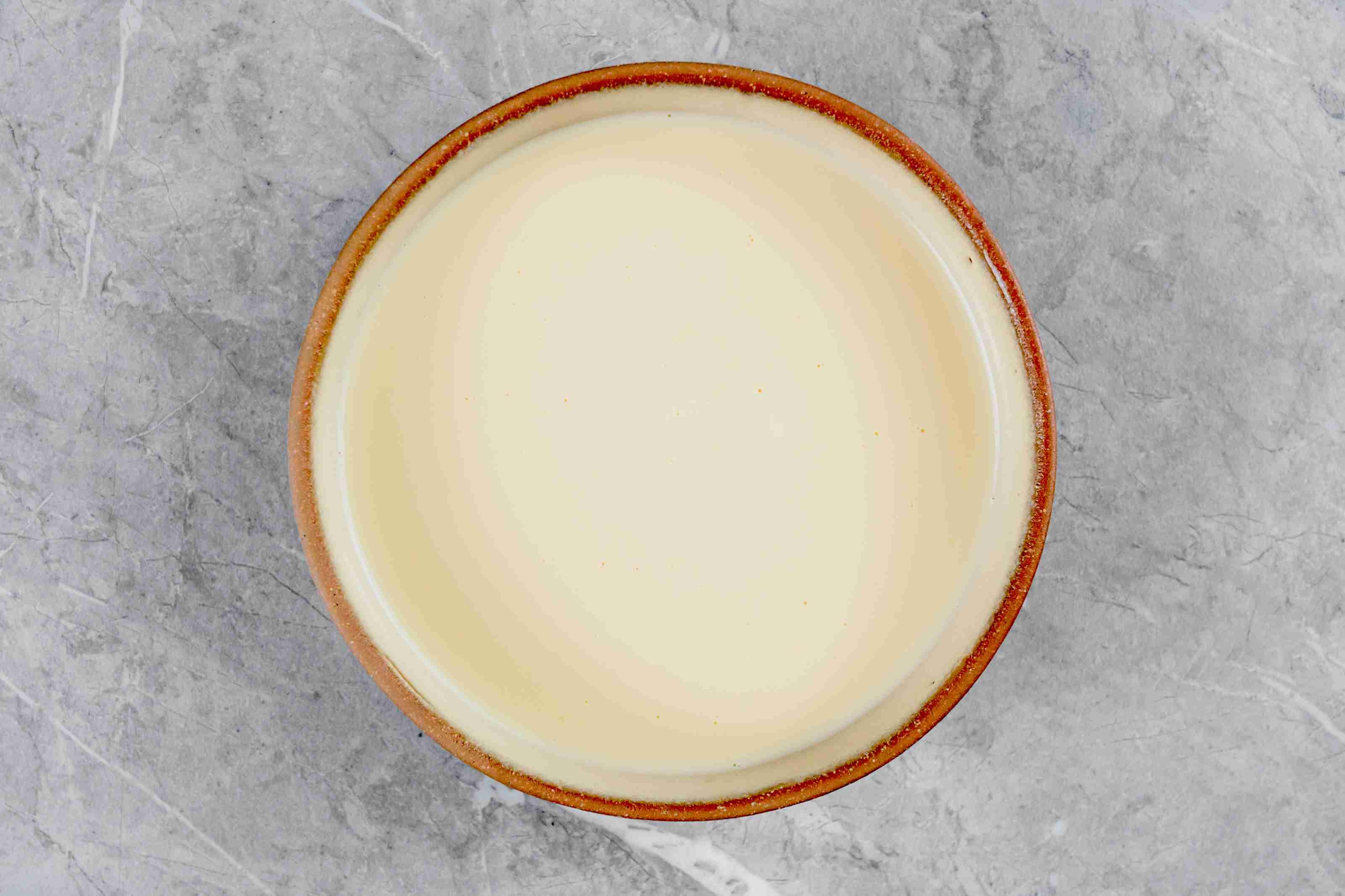 Whisk egg yolk and milk