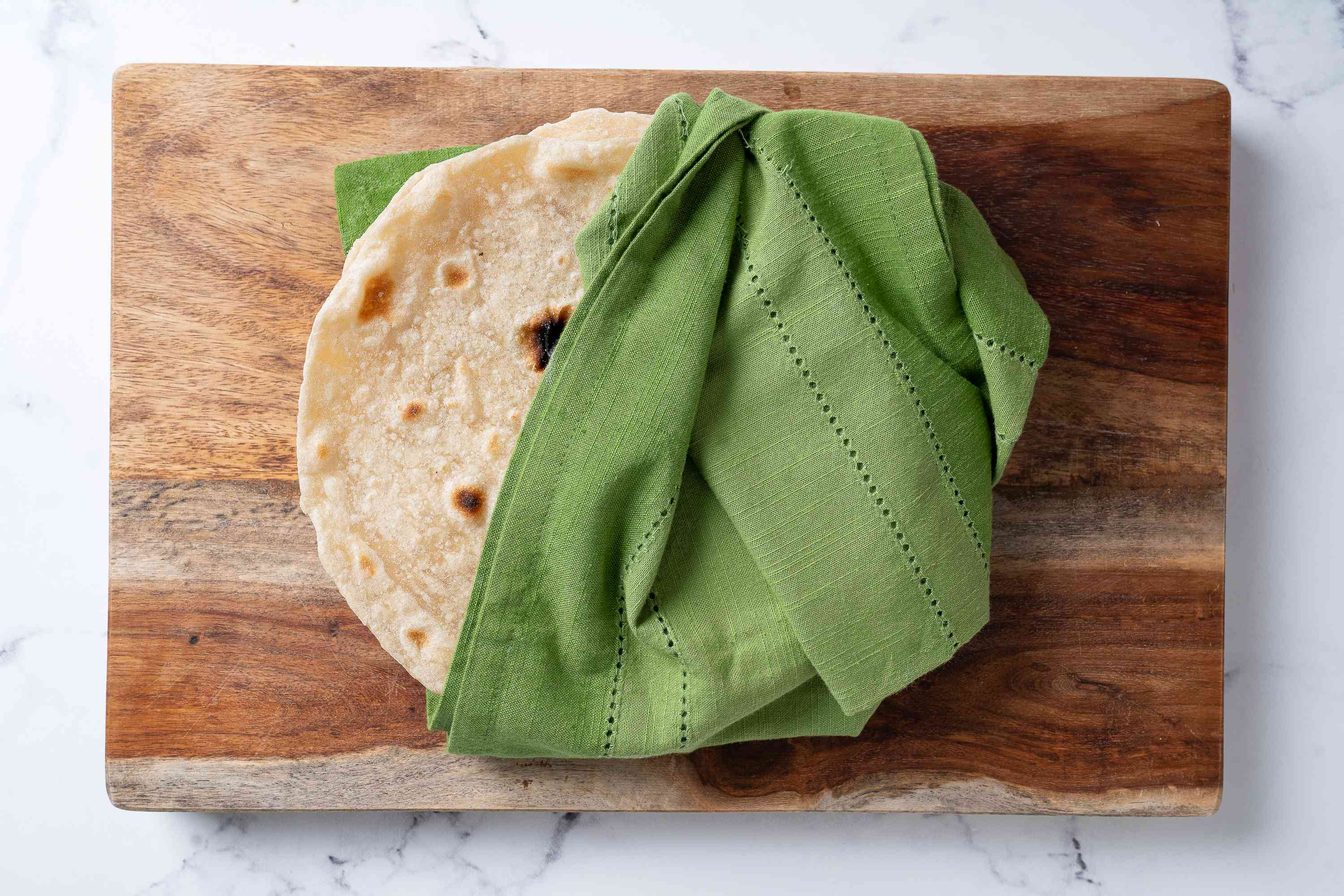 Homemade Flour Tortillas wrapped in a towel