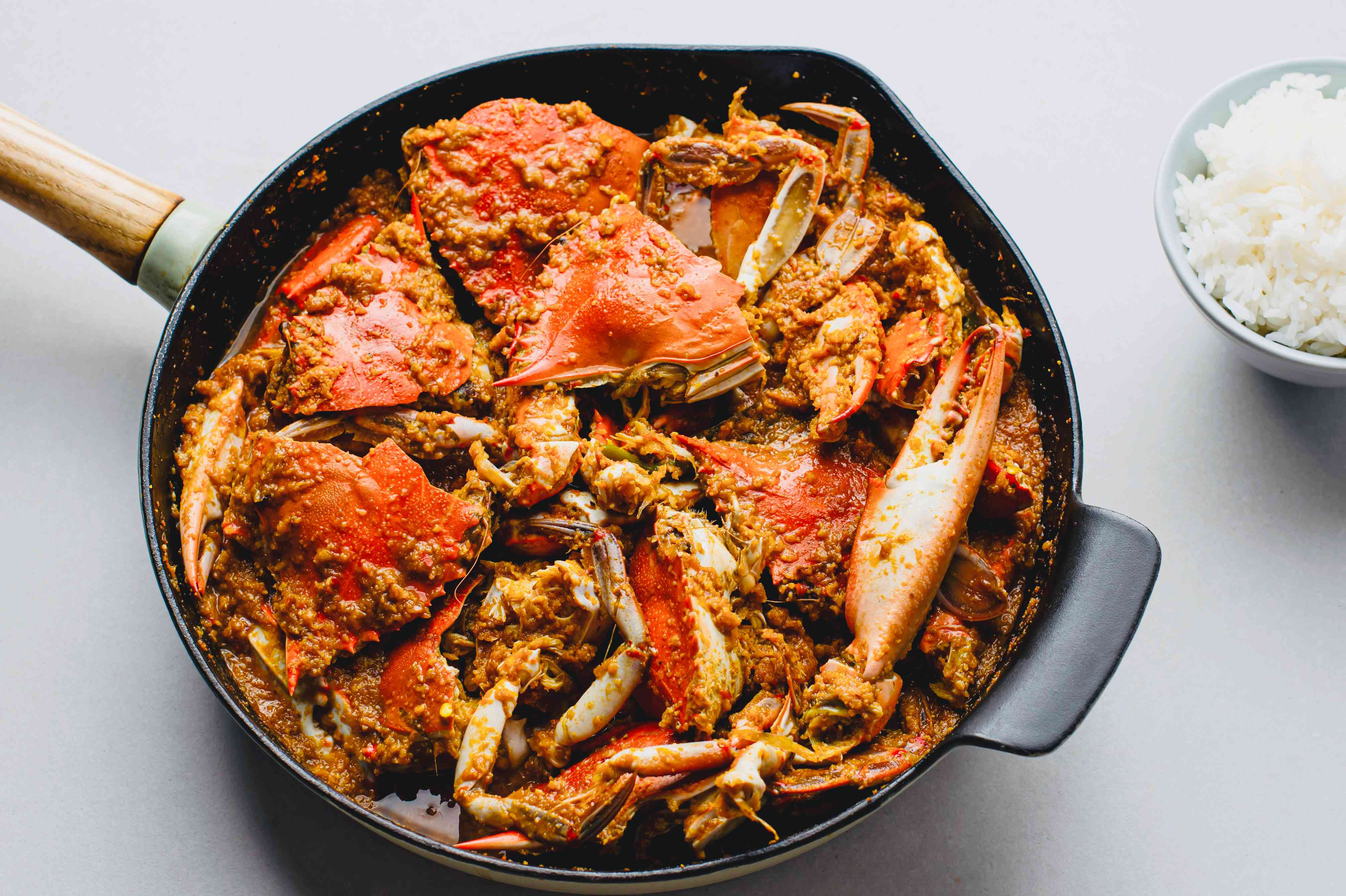 Indian Crab Curry in a pan, side of rice