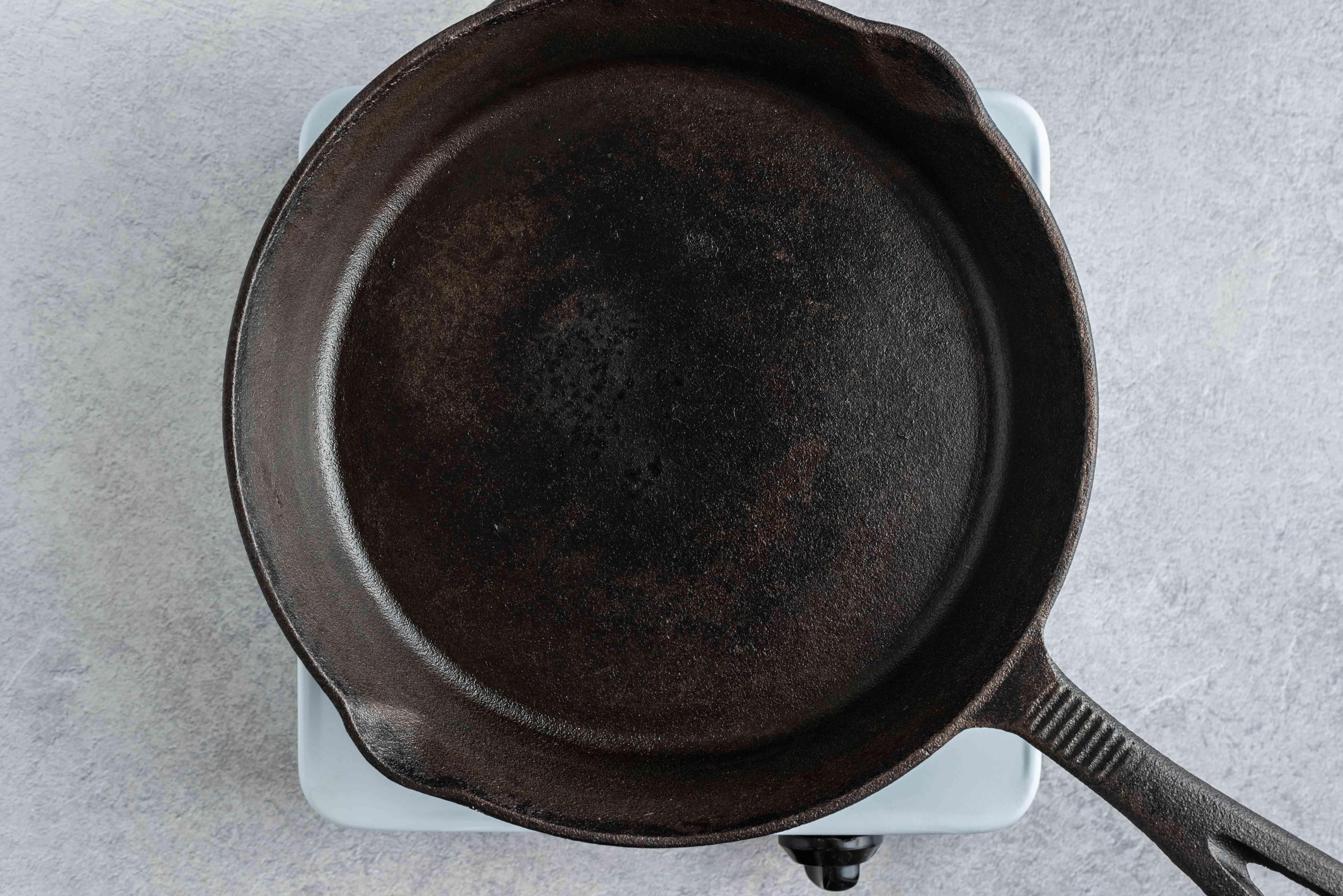 cast-iron pan on a burner