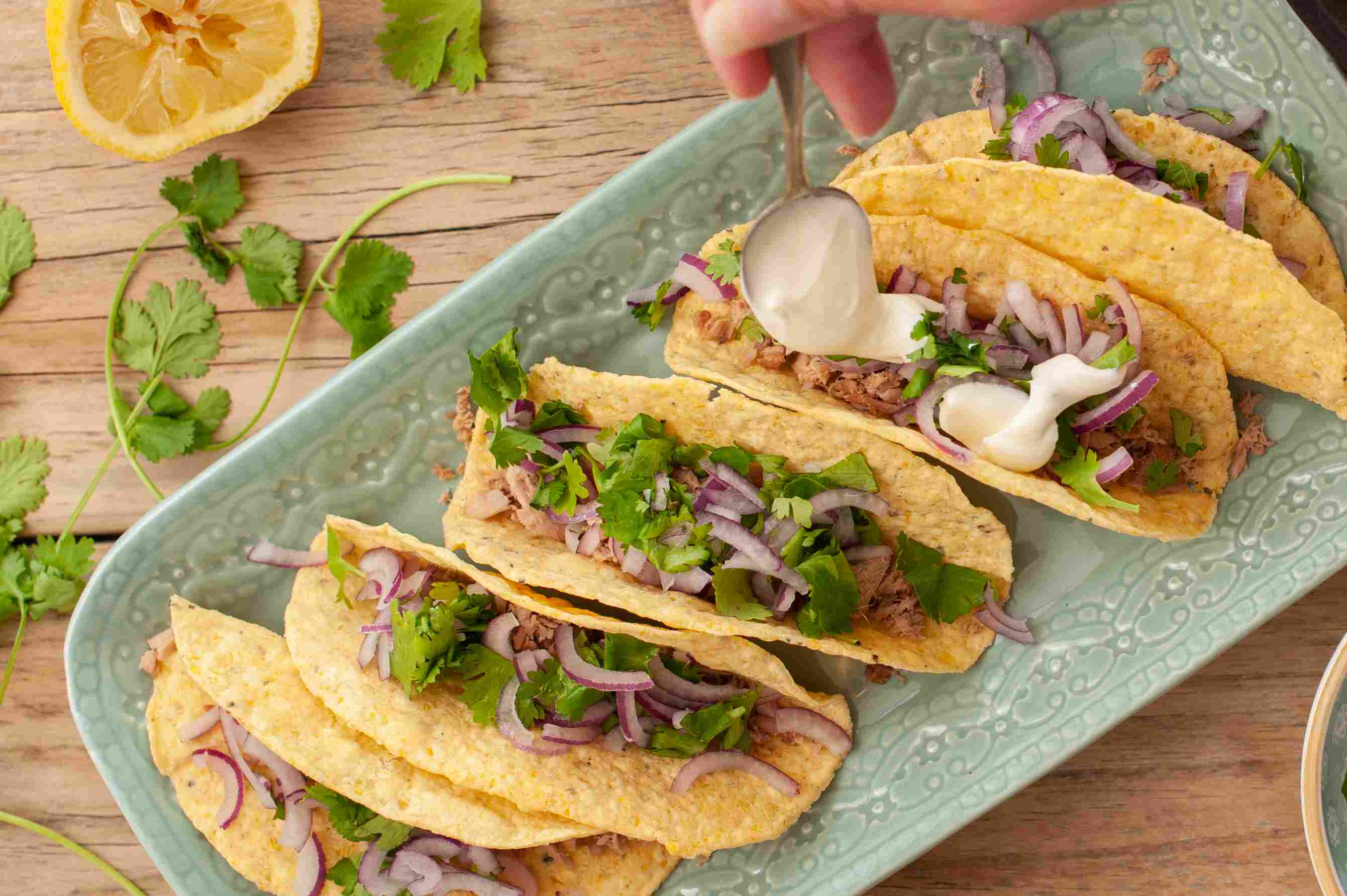 Topping tuna tacos with cream sauce