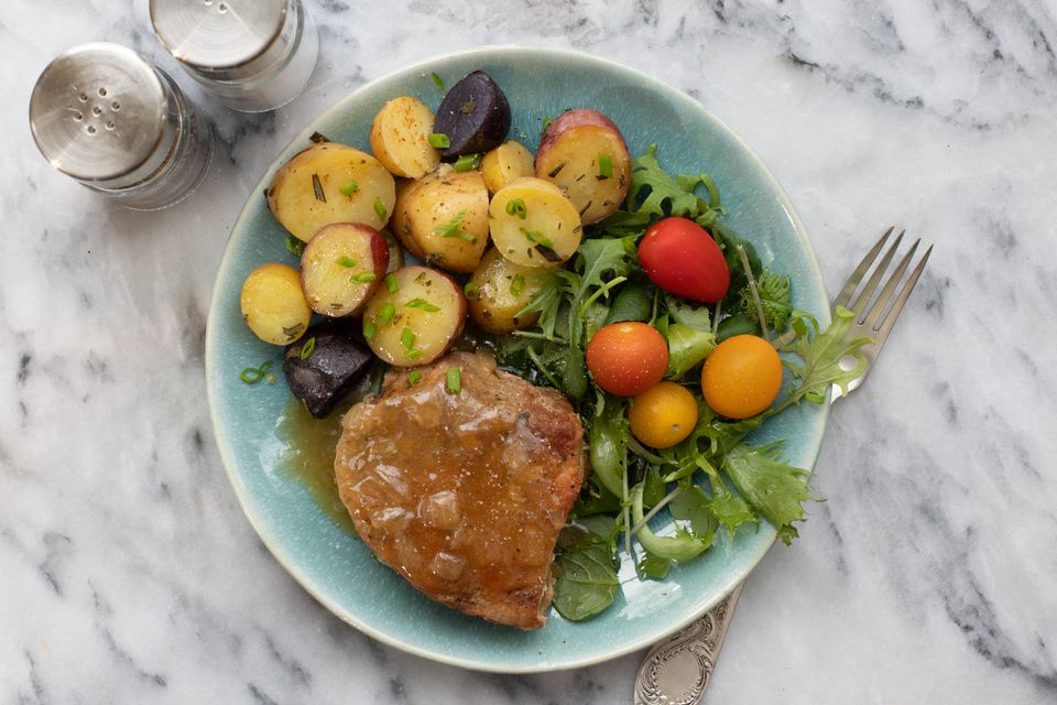 pork chops and potatoes on a plate with salad