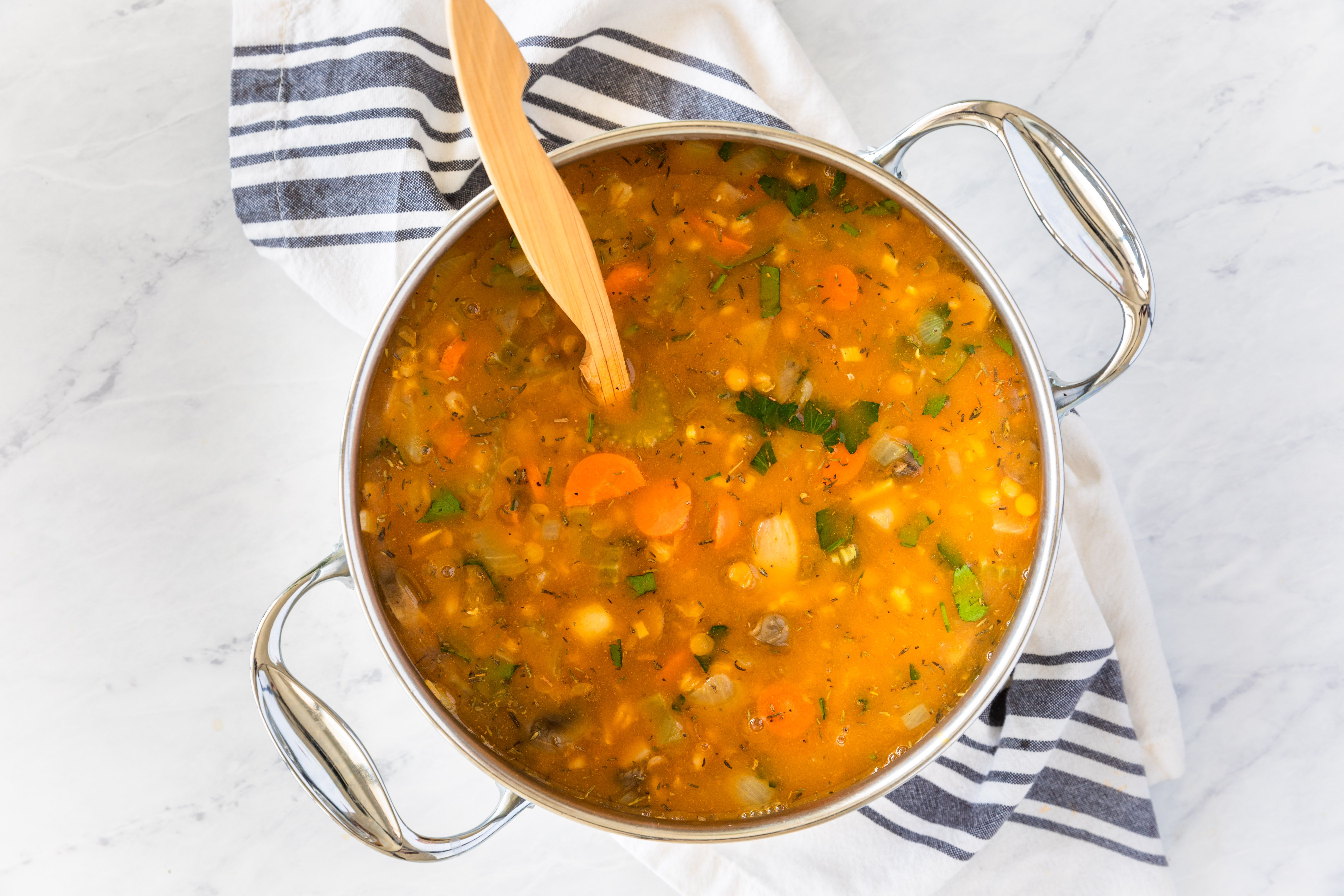 Barley vegetable soup with lentils in saucepan
