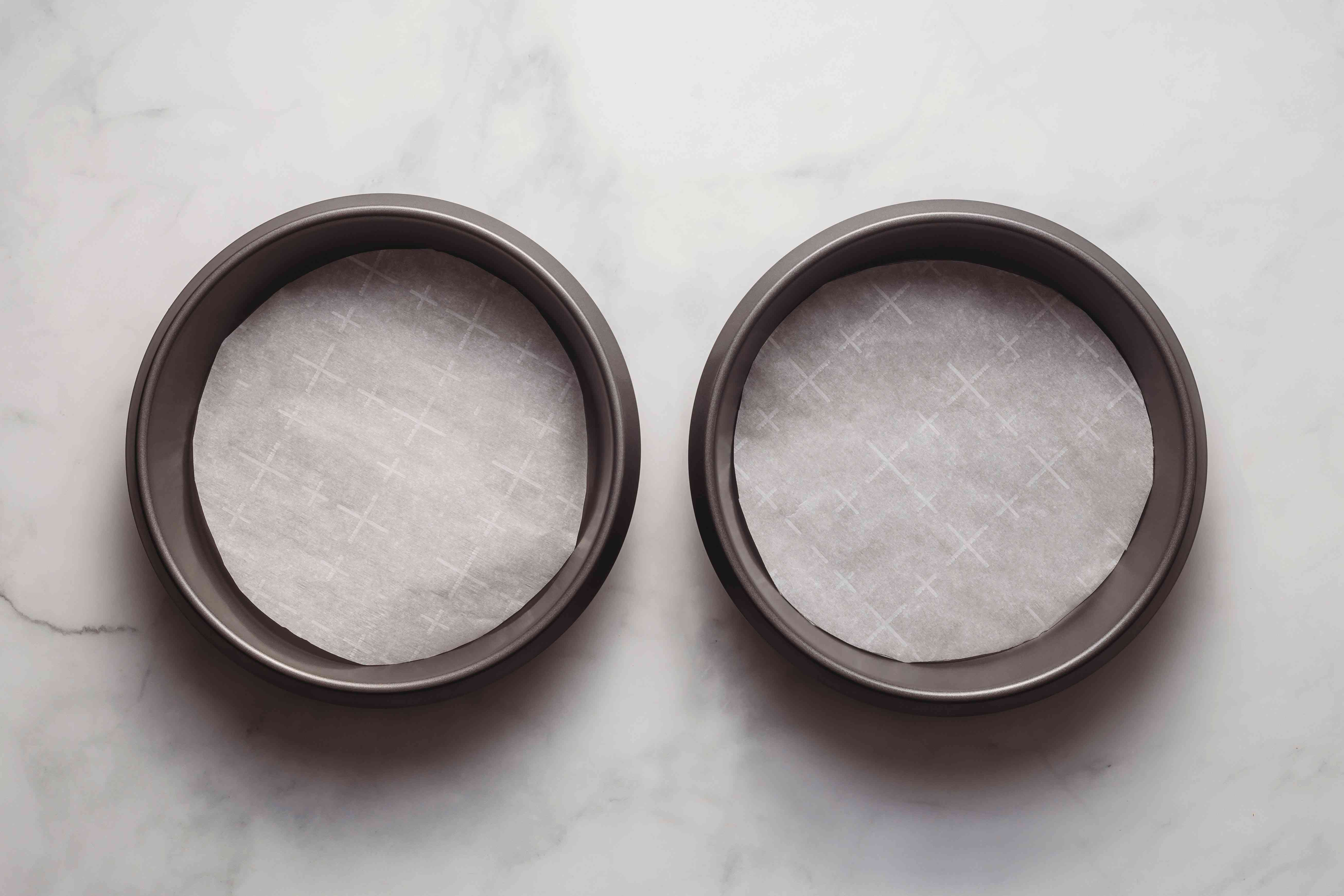 Grease and line two round cake pans with parchment paper