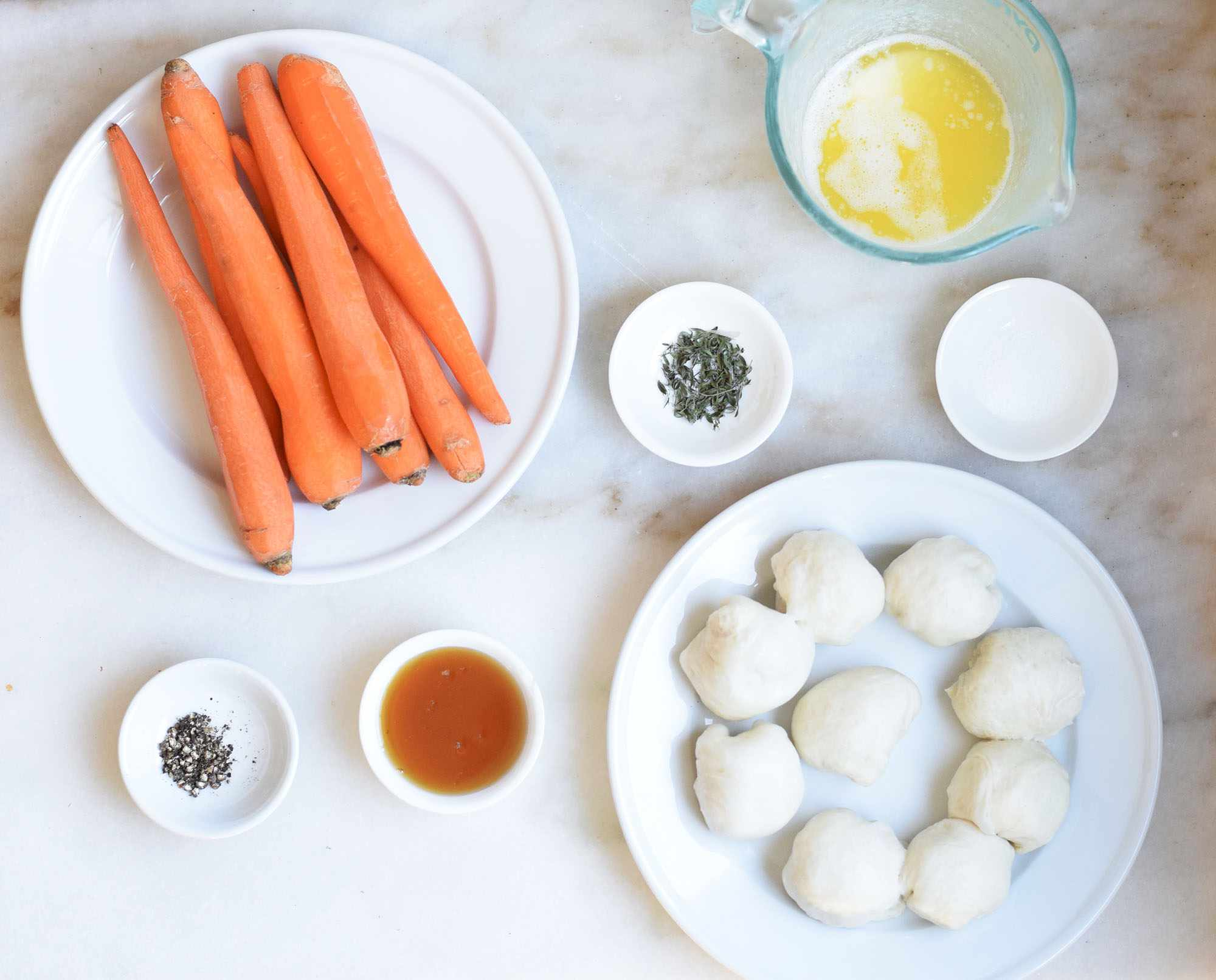 Ingredients for preparing carrots and dinner rolls