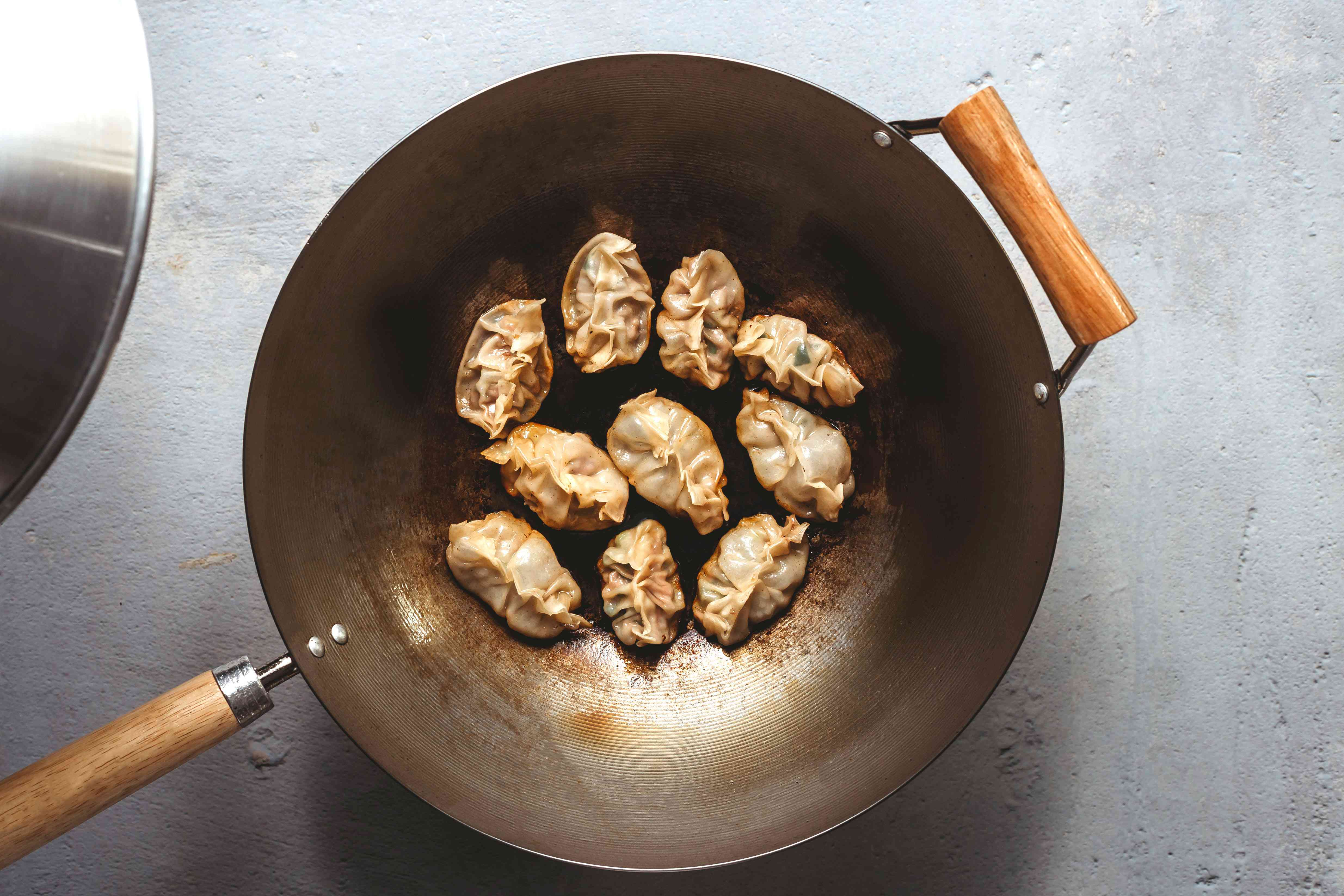 Steaming the dumplings in a wok
