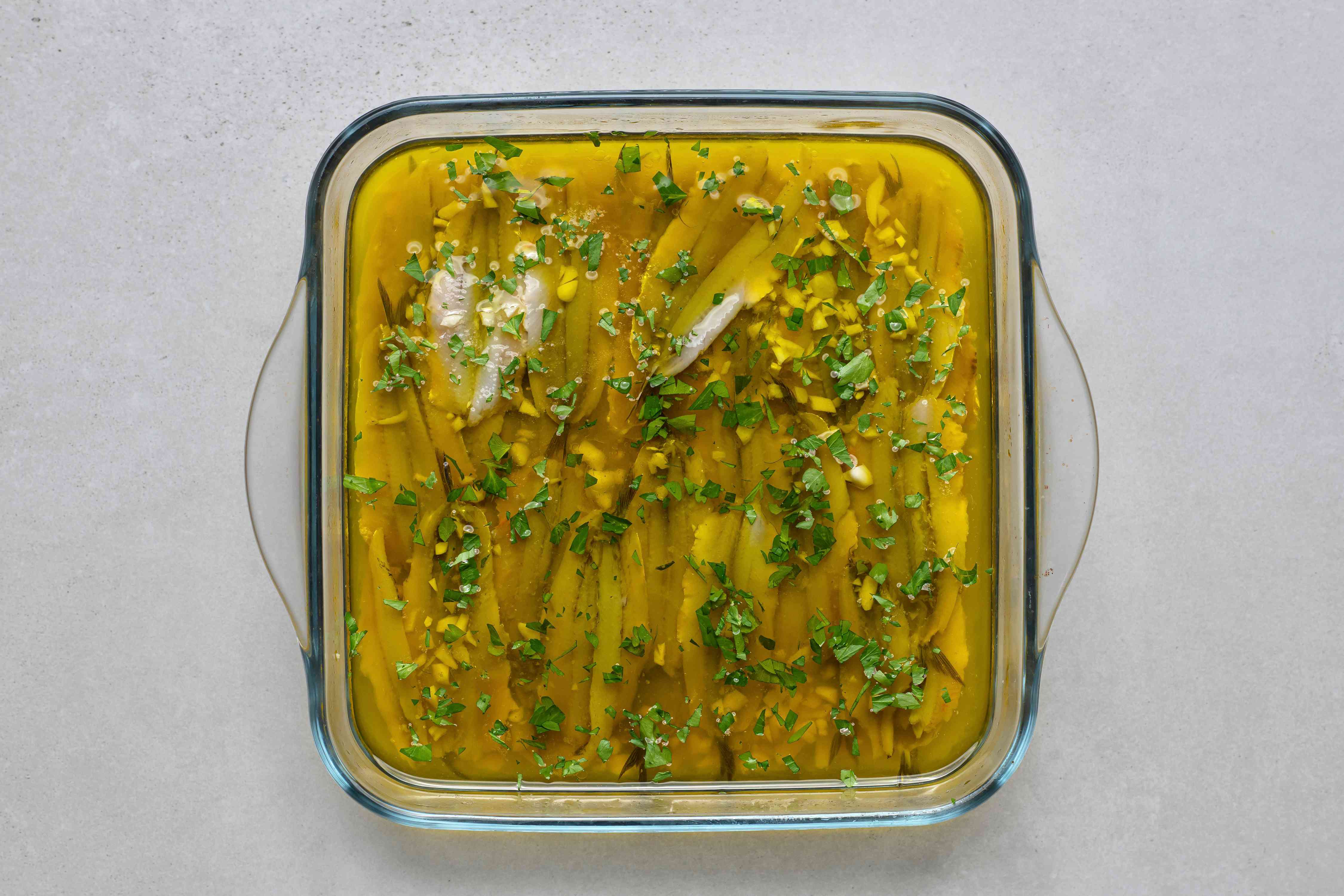 Anchovies Marinated in Vinegar (Boquerones en Vinagre) in a glass baking dish
