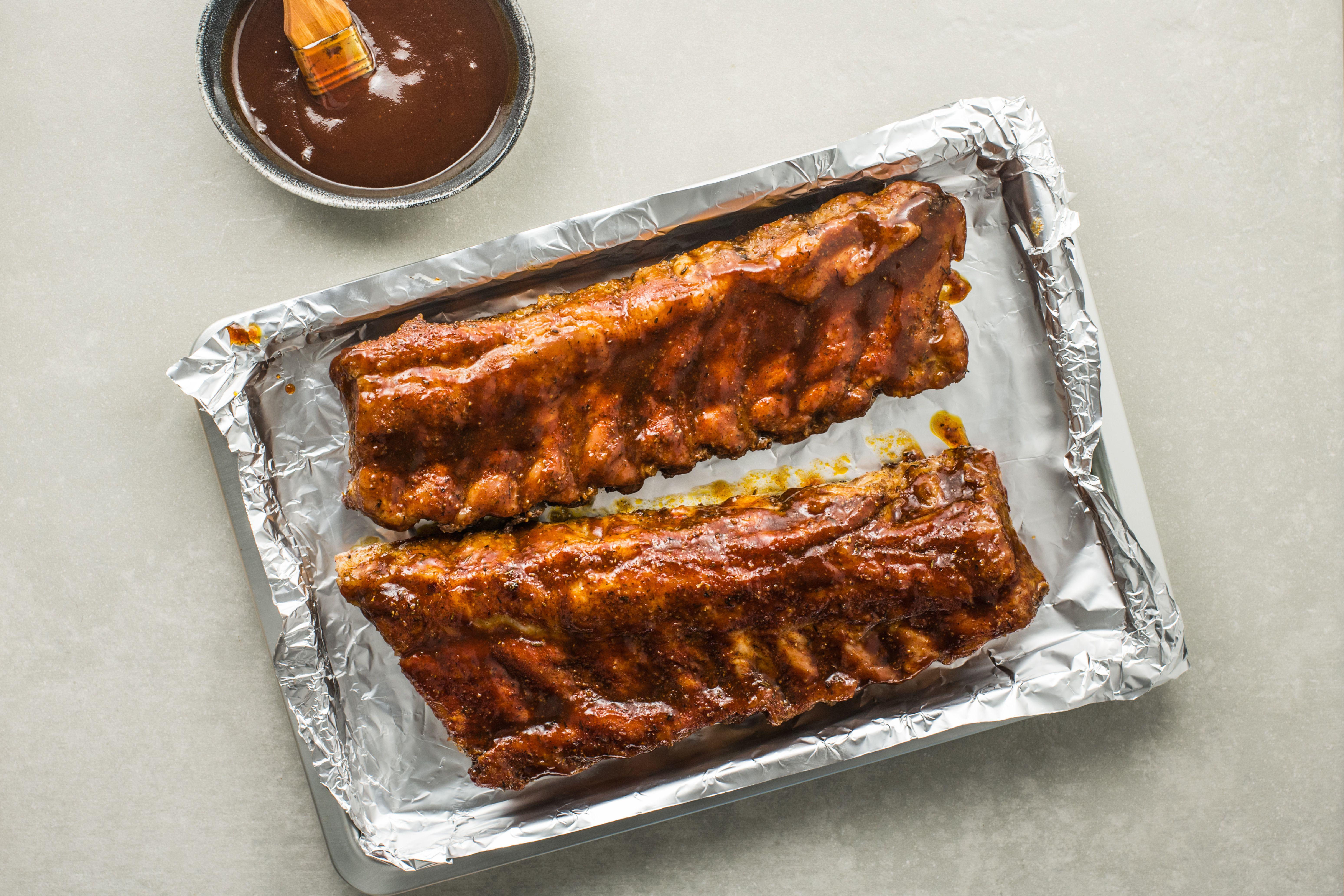 Rib racks coated in barbecue sauce