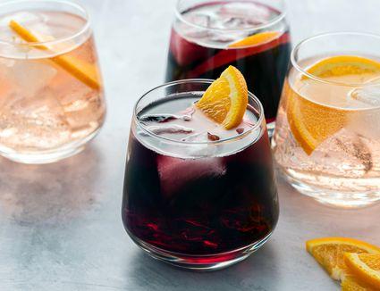 Wine spritzers garnished with orange slices