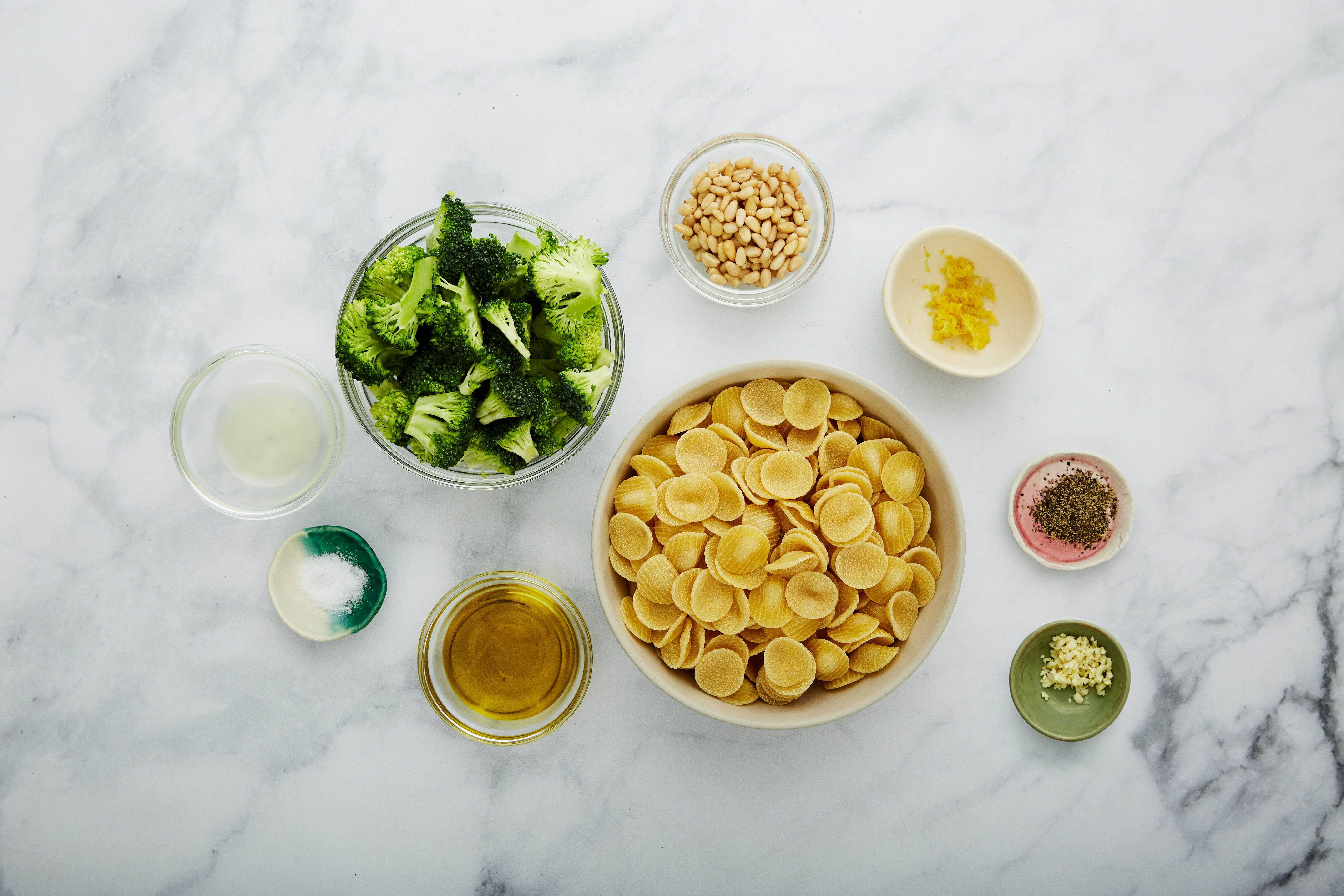 Ingredients for lemon pasta with pine nuts and broccoli