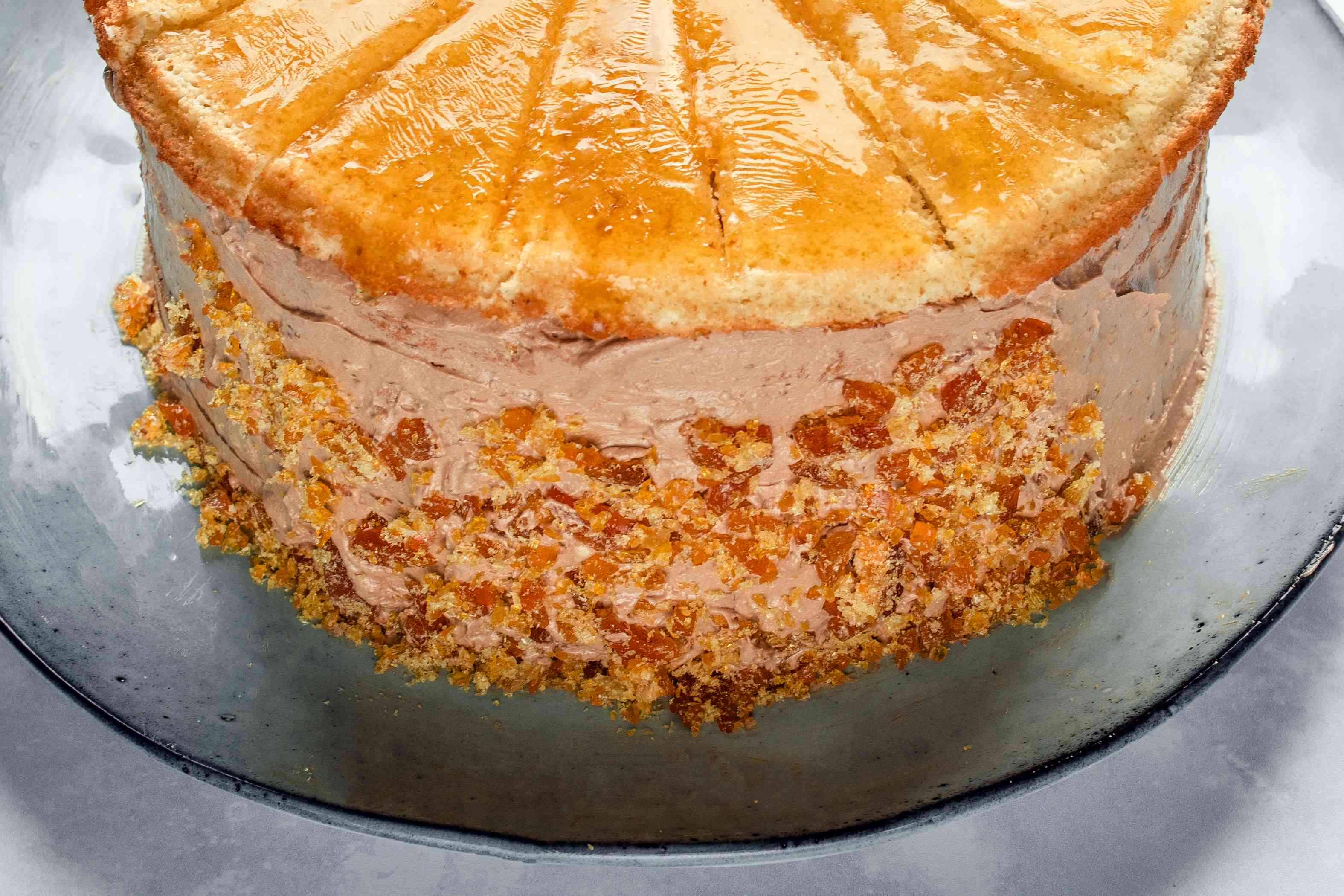 Sides of the torte decorated with nuts
