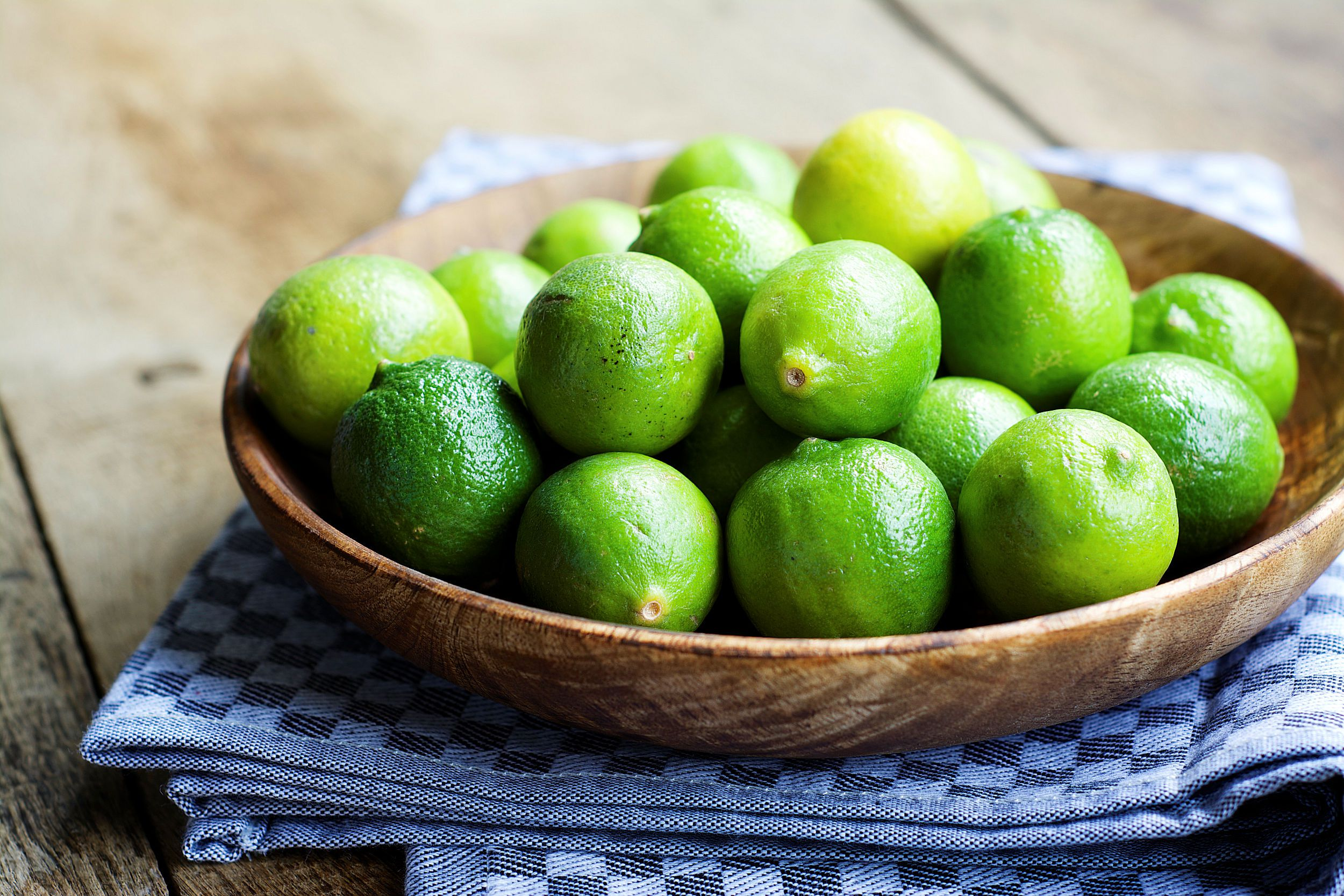 Whole Mexican Limes in bowl