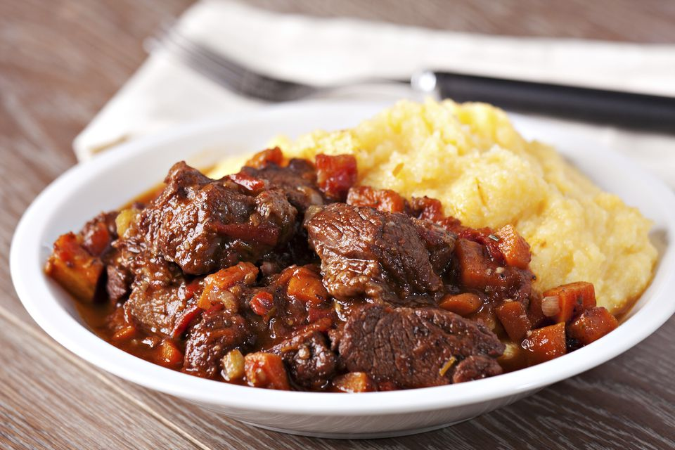 Tuscan wild boar stew in chocolate sauce with polenta