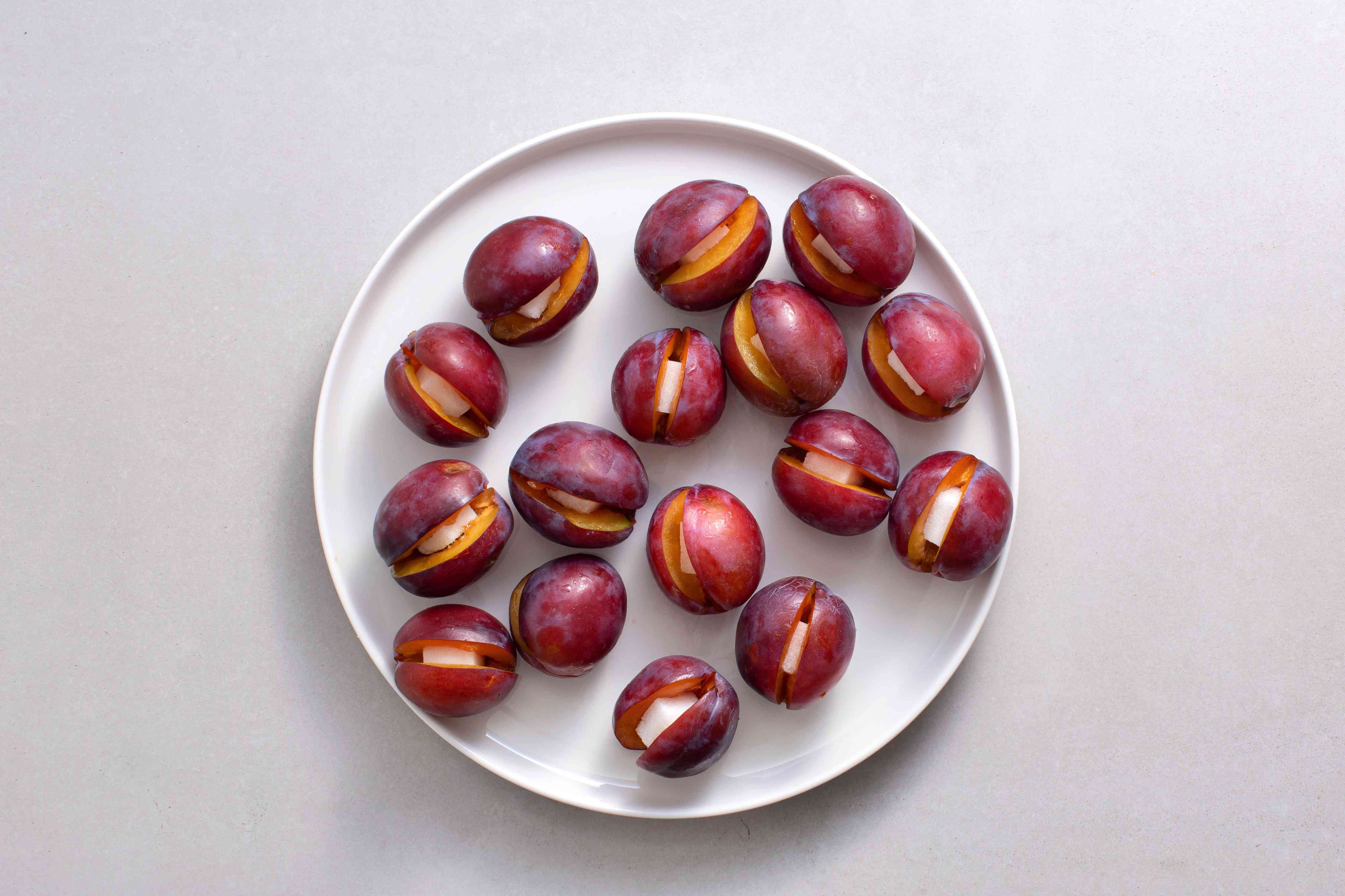 plum with sugar cubes on a plate